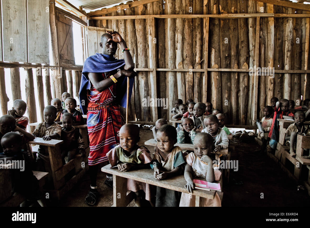 Children and teacher in a Massai village school, Kenya, Africa Stock Photo