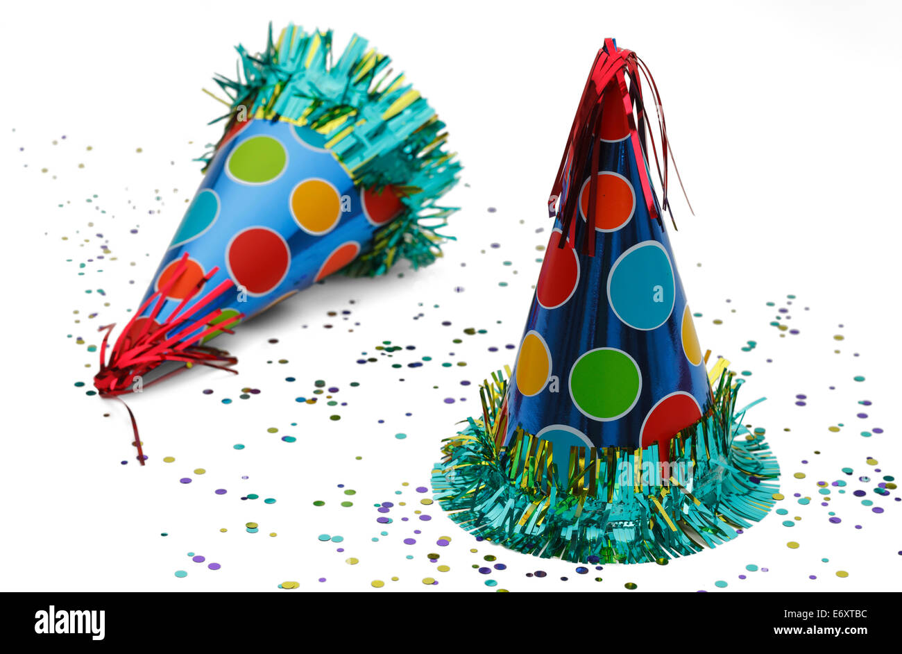 Two Celebration Hats with Confetti Isolated on White Background. - Stock Image