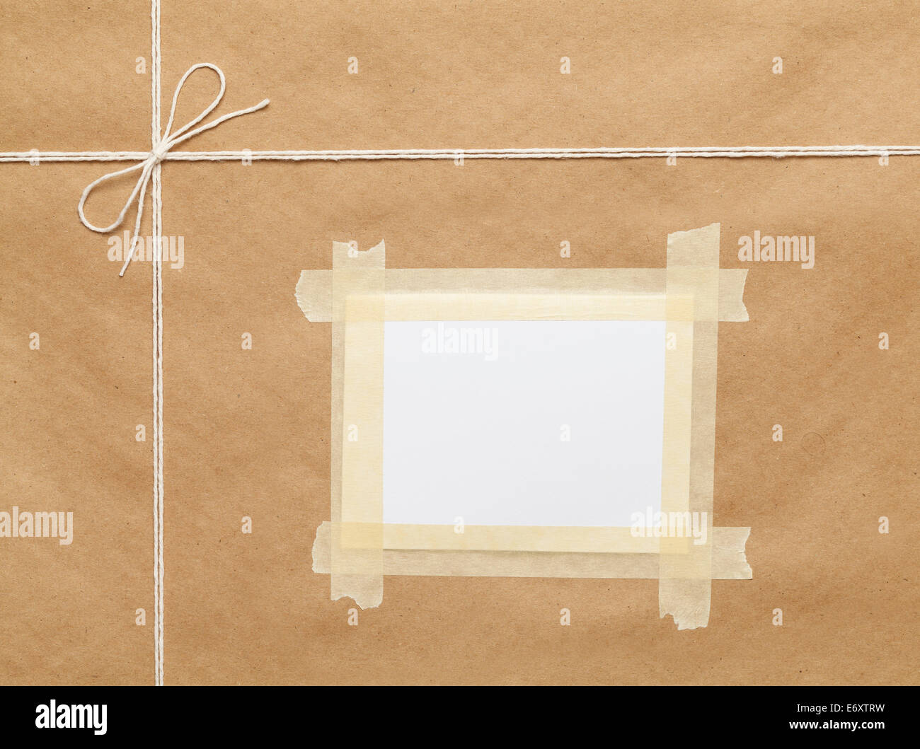 Brown Wrapped Package  with String And Copy Space. - Stock Image