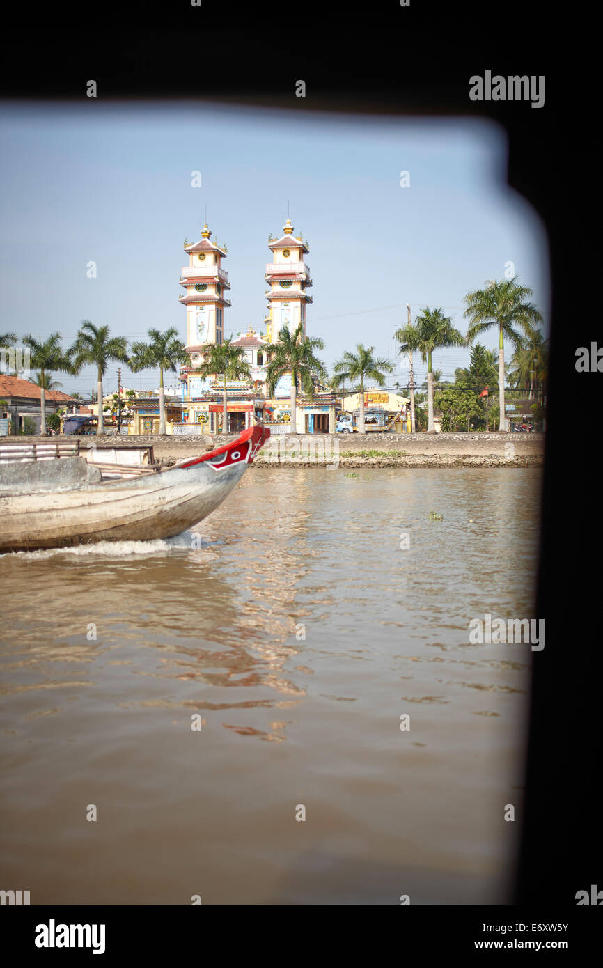 View over river Mekong to Cao Dai temple, Sa Dec, Dong Thap, Vietnam - Stock Image