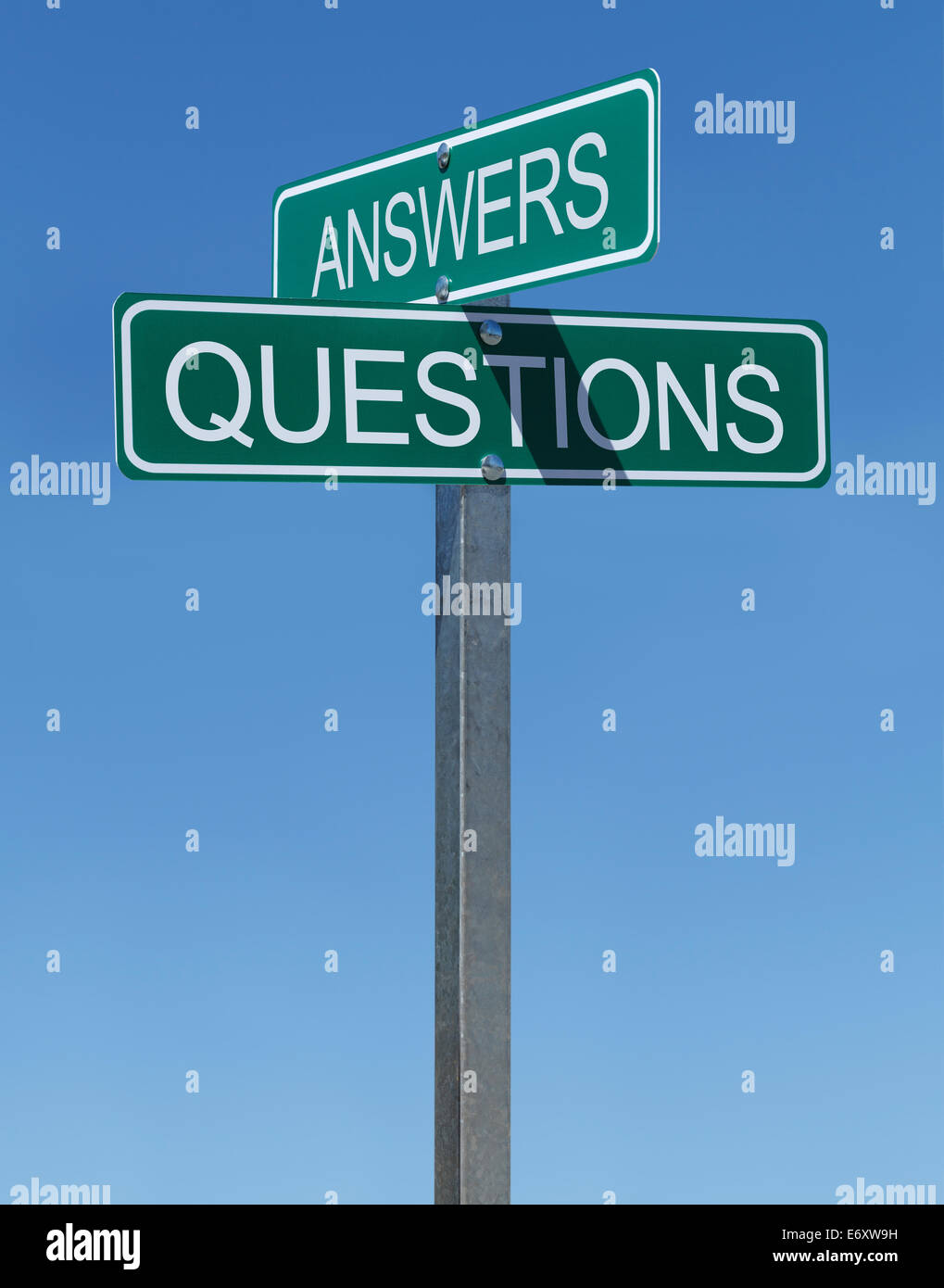 Two Green Street Signs Answers Questions on Metal Pole With