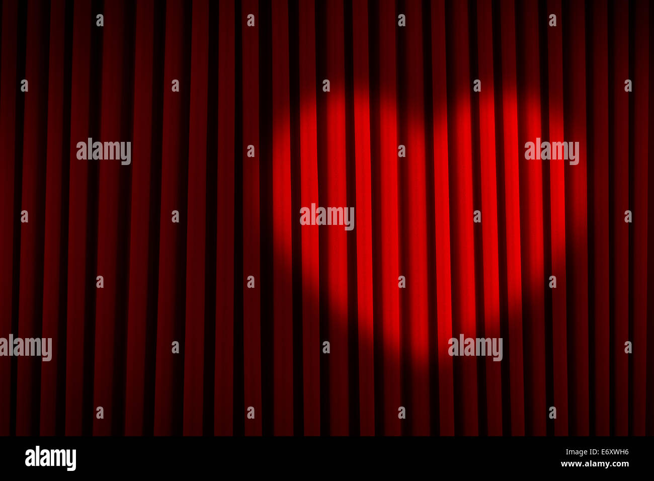 Red Velvet Stage Curtain with Heart Spotlight. - Stock Image
