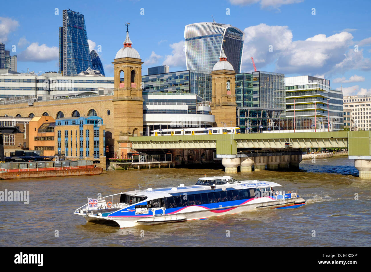 London river Thames embankment showing Thames cruise boat plus buildings and london skyline in background, - Stock Image