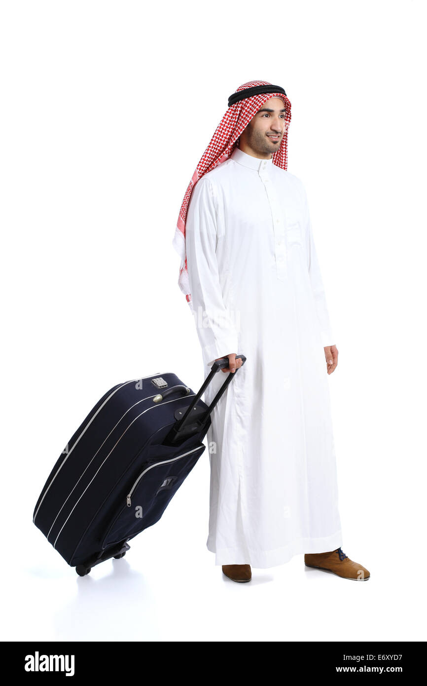 Arab traveler saudi man carrying a suitcase isolated on a white background - Stock Image