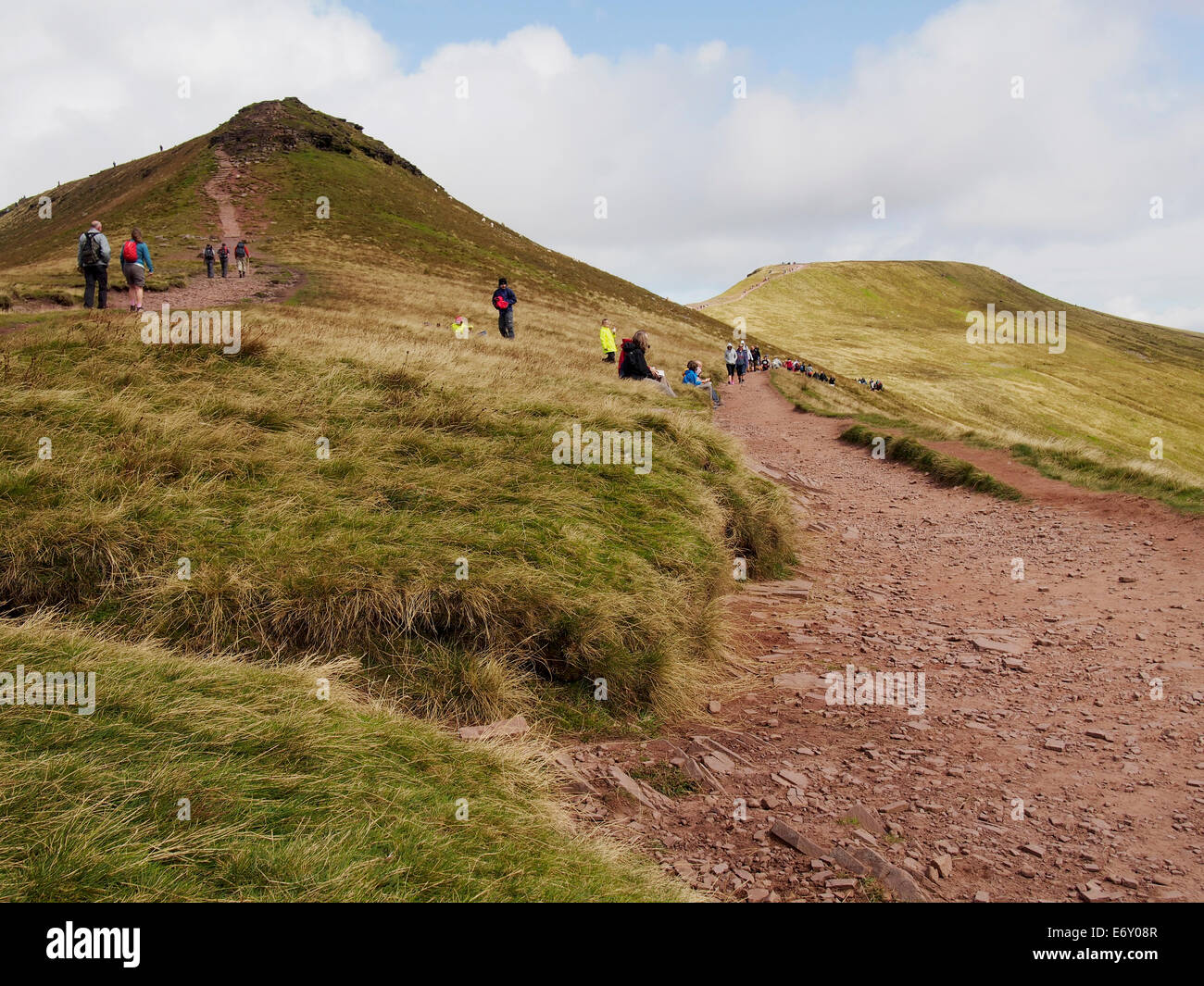Hill walking on the Brecon Beacons. Summit of Corn Du (left) and Pen y Fan (right) with hill walkers on a summer - Stock Image