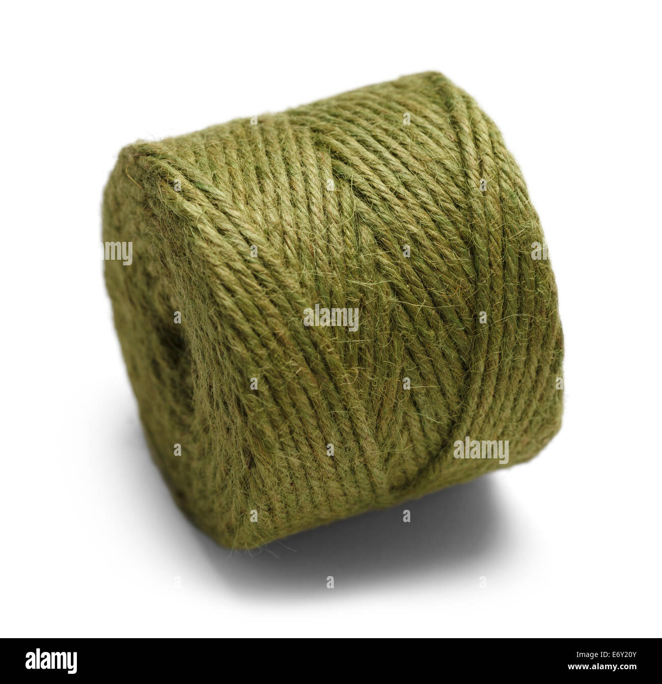Green Rope Wound in a Spool Isolated on White Background. - Stock Image