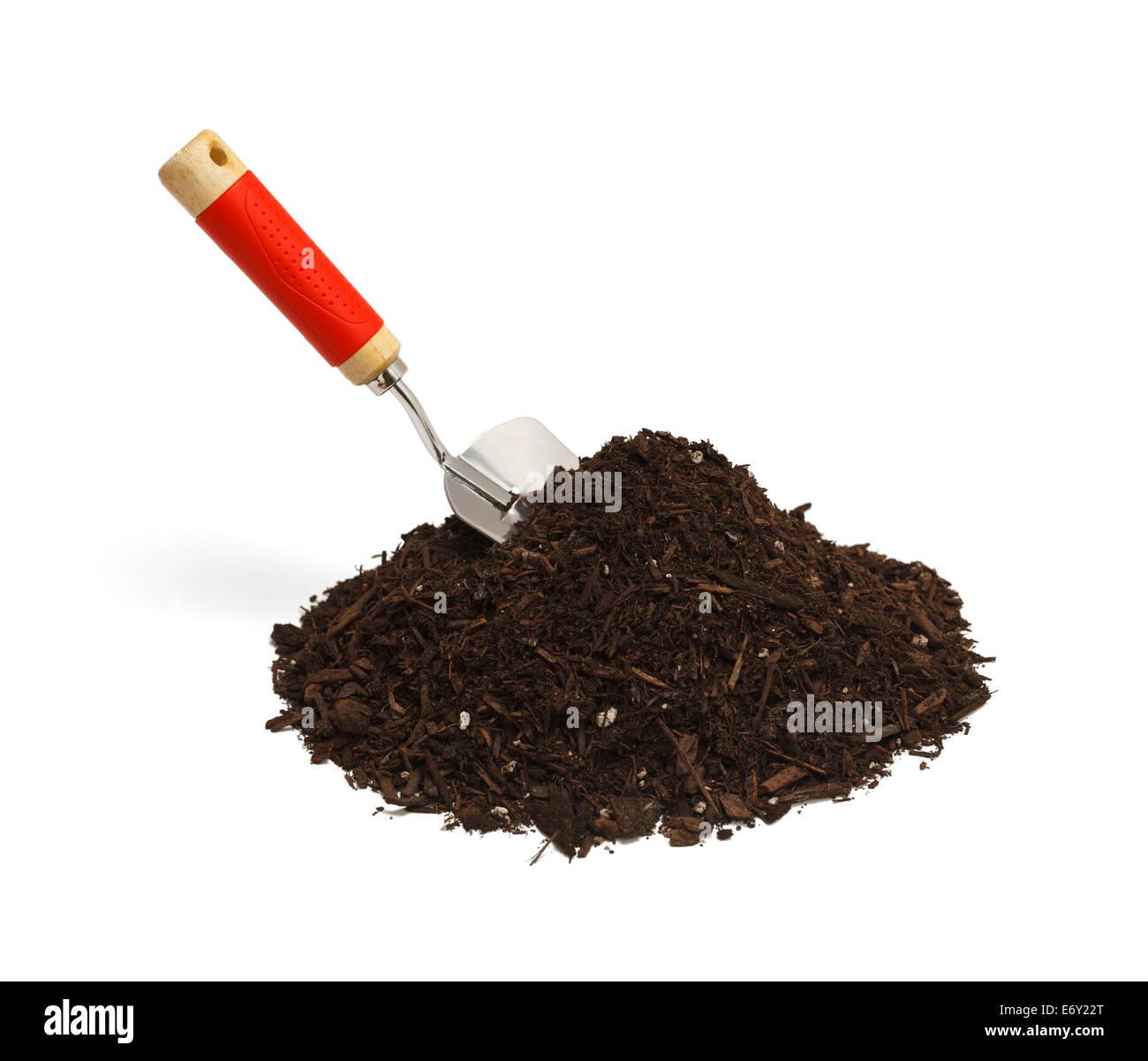 Garden Soil with Hand Shovel Isolated on White Background. - Stock Image
