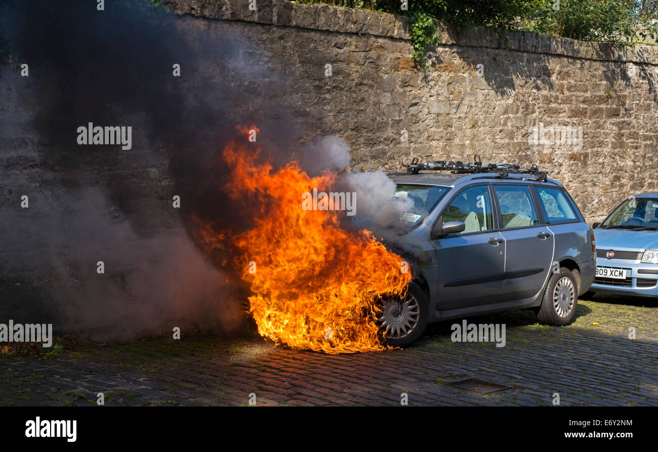 A quiet Sunday morning in a residential street in Edinburgh a motor vehicle catches fire, probably due to an electrical - Stock Image