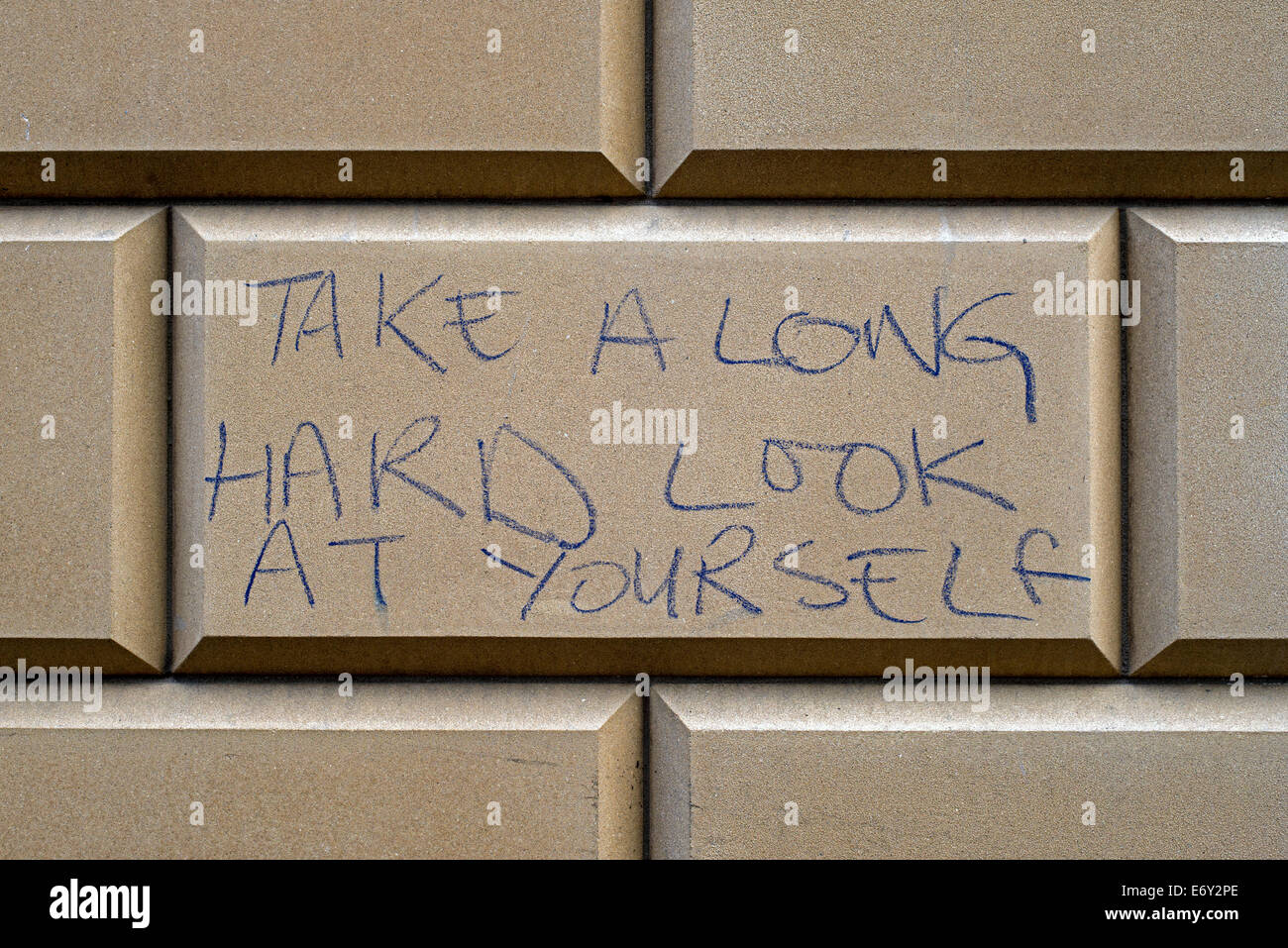A useful piece of advice written on a sandstone building in Edinburgh, Scotland, UK. - Stock Image