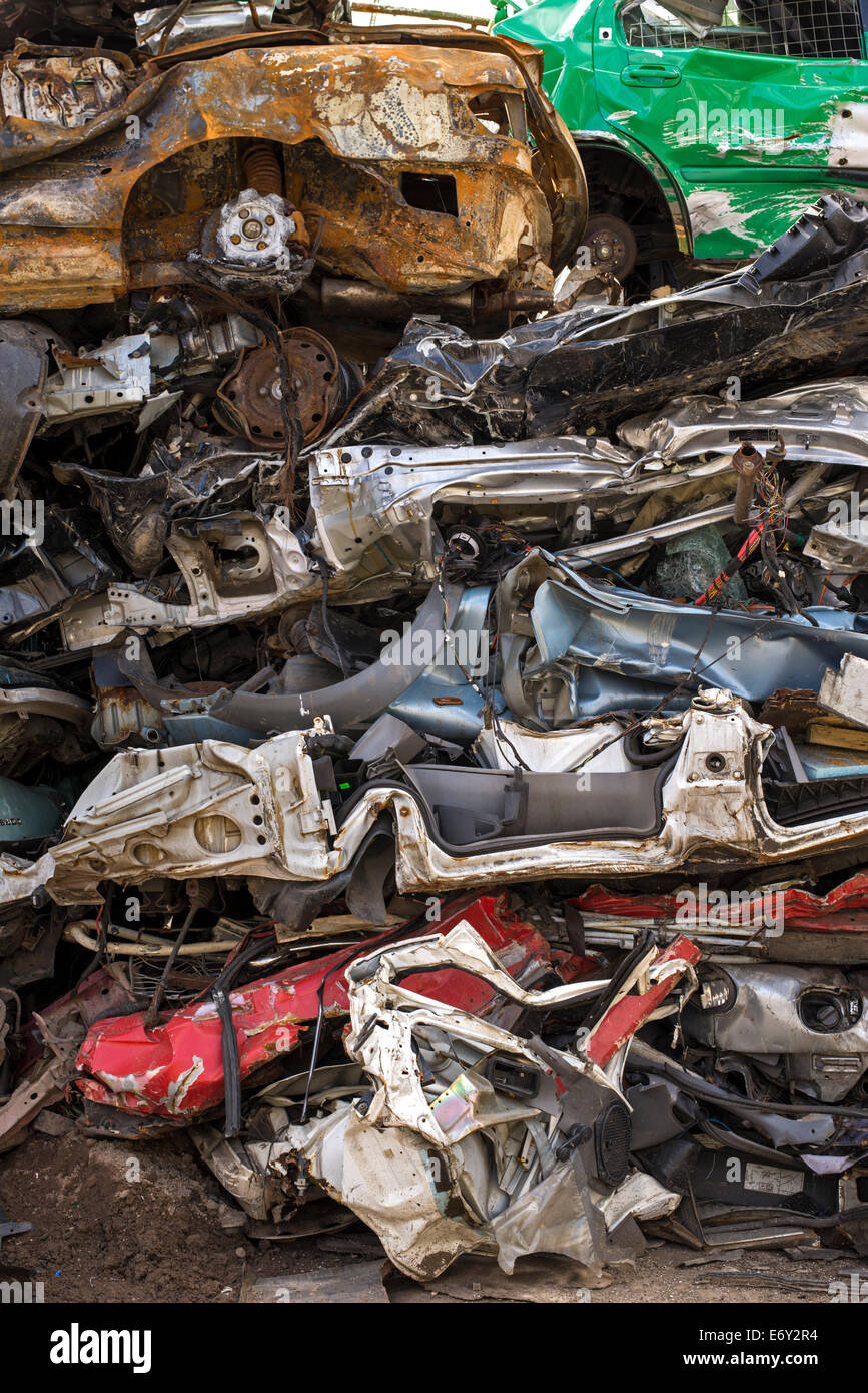 A pile of crushed cars in a scrapyard. Stock Photo