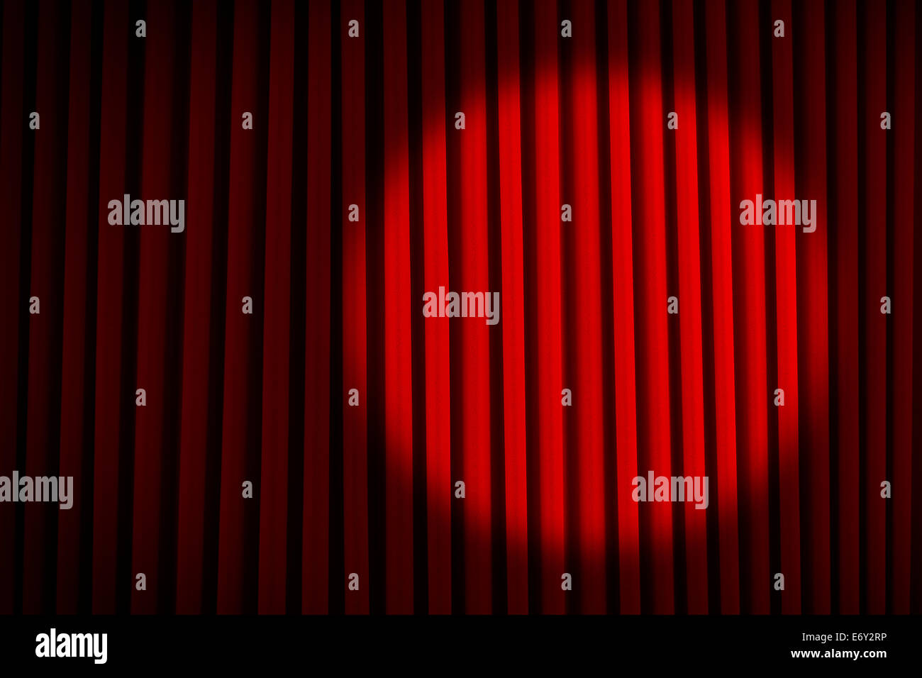 Red Velvet Stage Curtains with Round Spotlight. - Stock Image