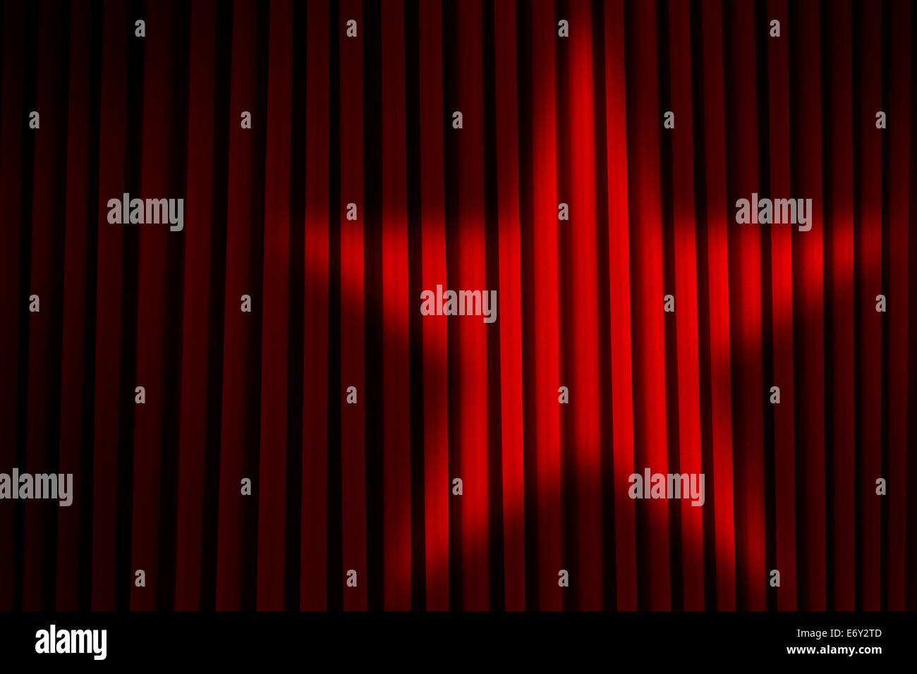 Red Theater Stage Curtains with Star Spotlight. - Stock Image