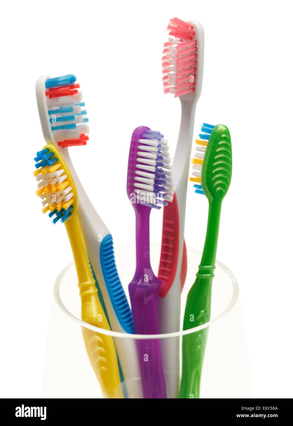 Group of Tooth Brushes in Glass Isolated on White Background. - Stock Image