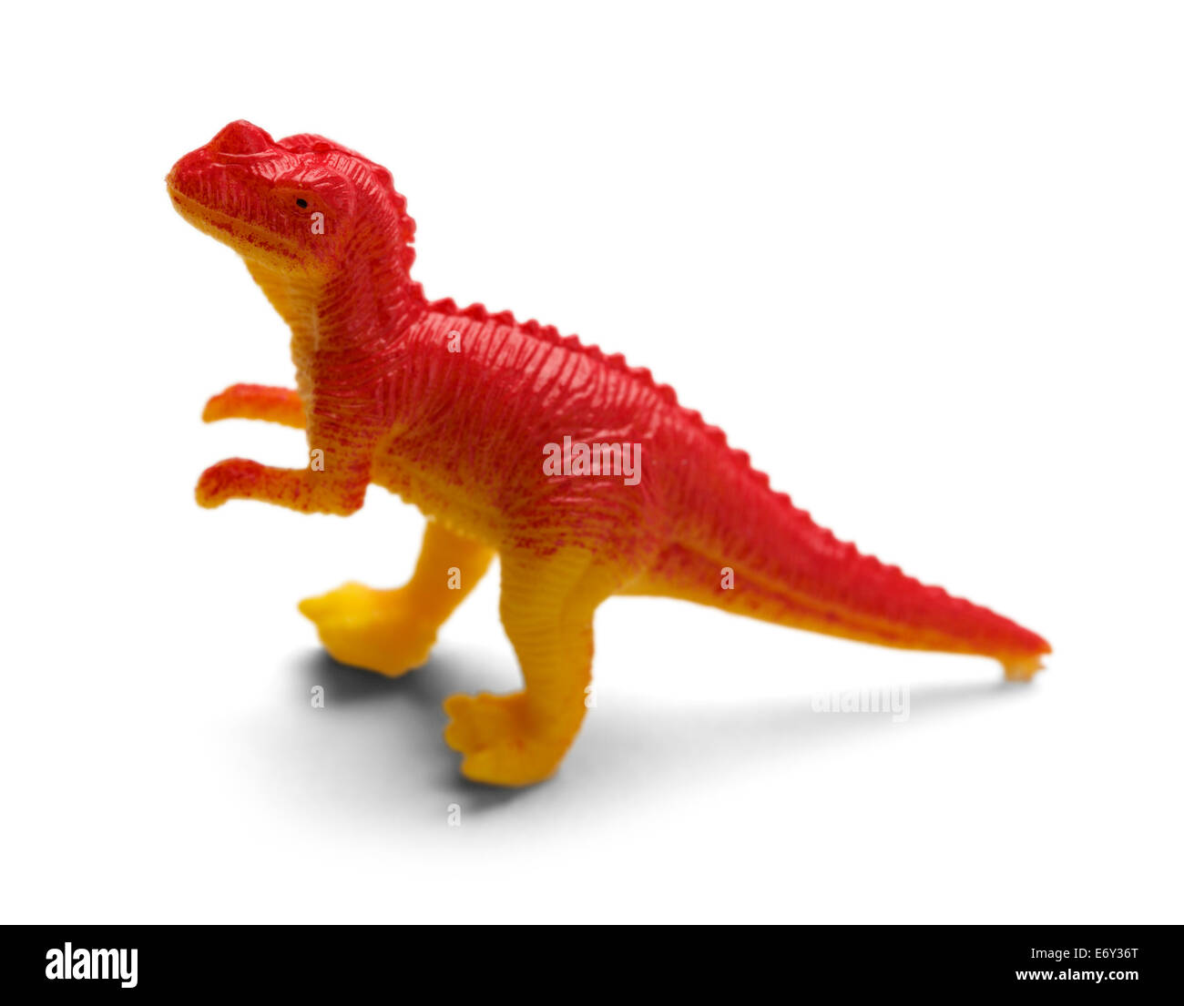 Plastic Red Dinosaur Isolated on White Background. - Stock Image