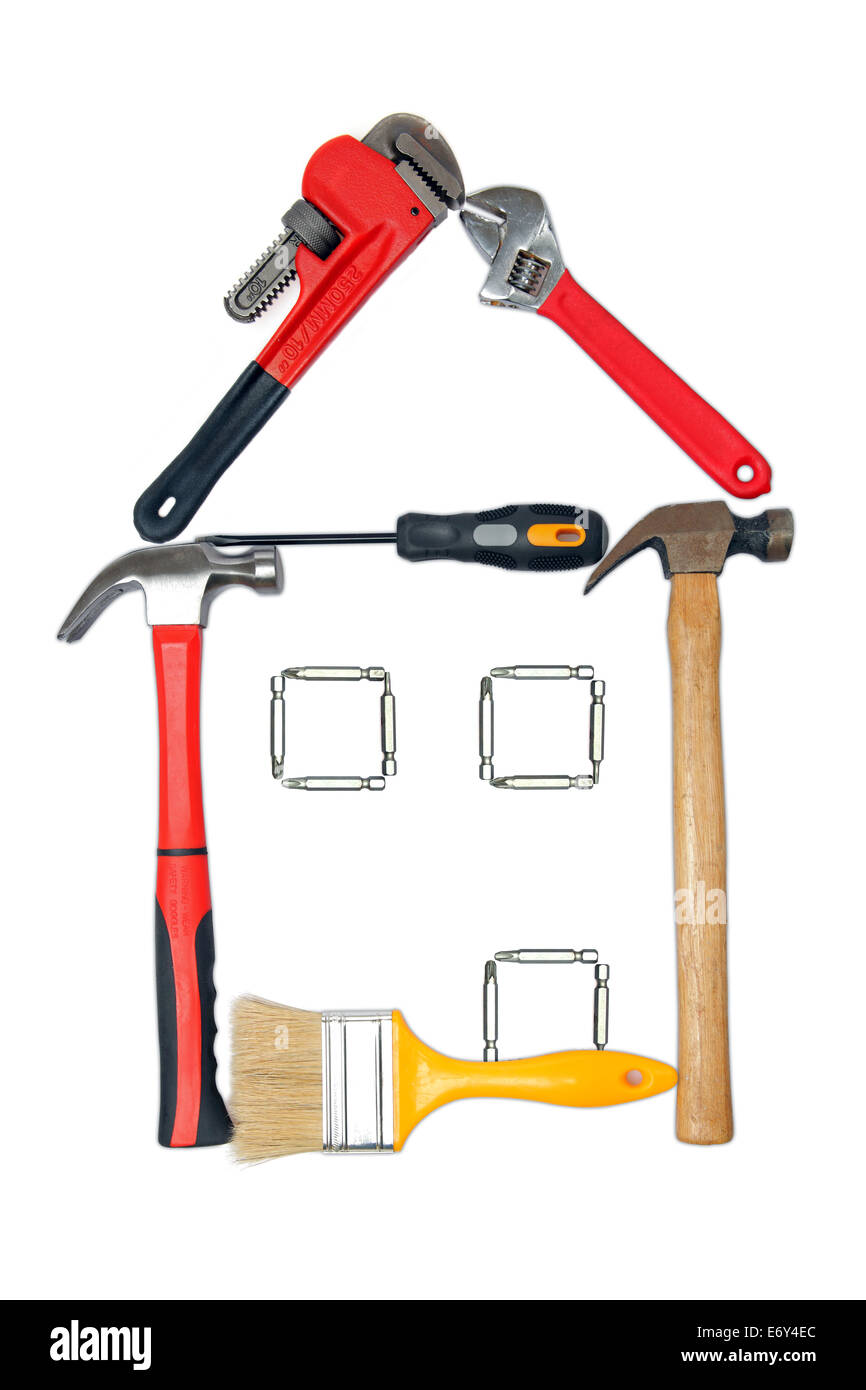 Collection of common household and construction tools that form the outline of a house. - Stock Image