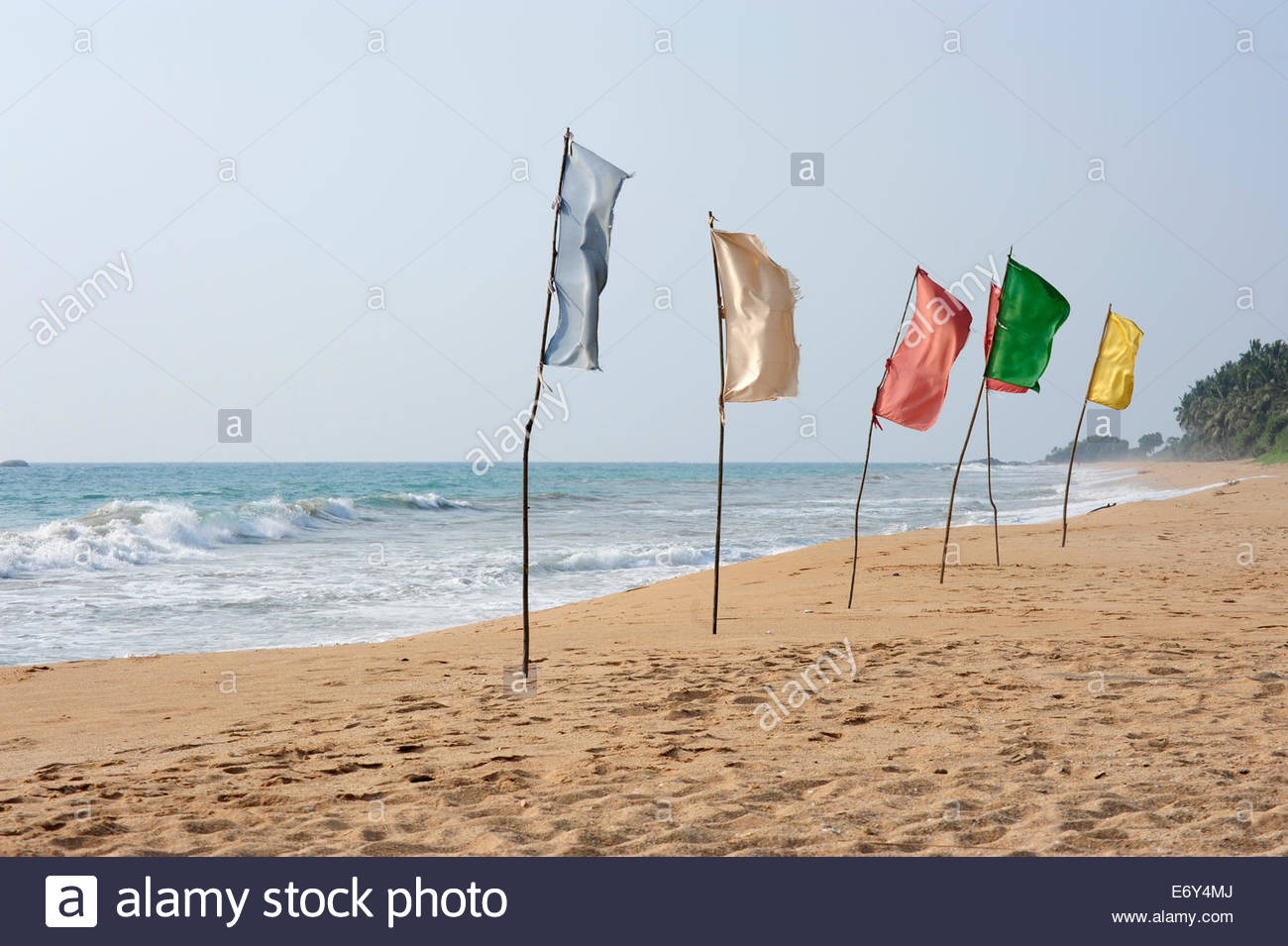 Colourful flags on the beach near Induruwa, Southern Province, Ceylon, Sri Lanka, Indian Ocean, Asia - Stock Image