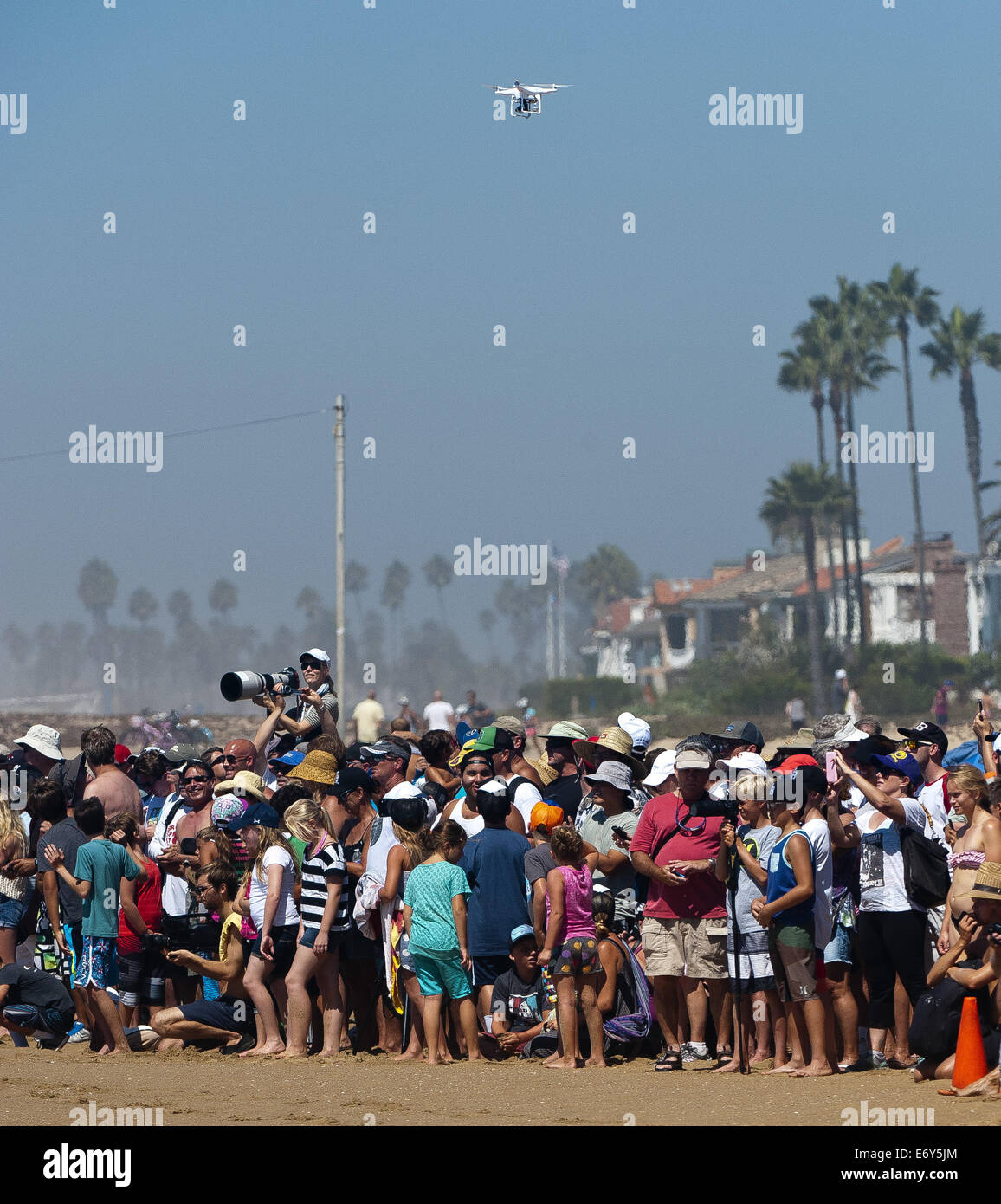 Newport Beach, California, USA. 27th Aug, 2014. A quadcopter drone equipped with camera equipment flies over a large - Stock Image