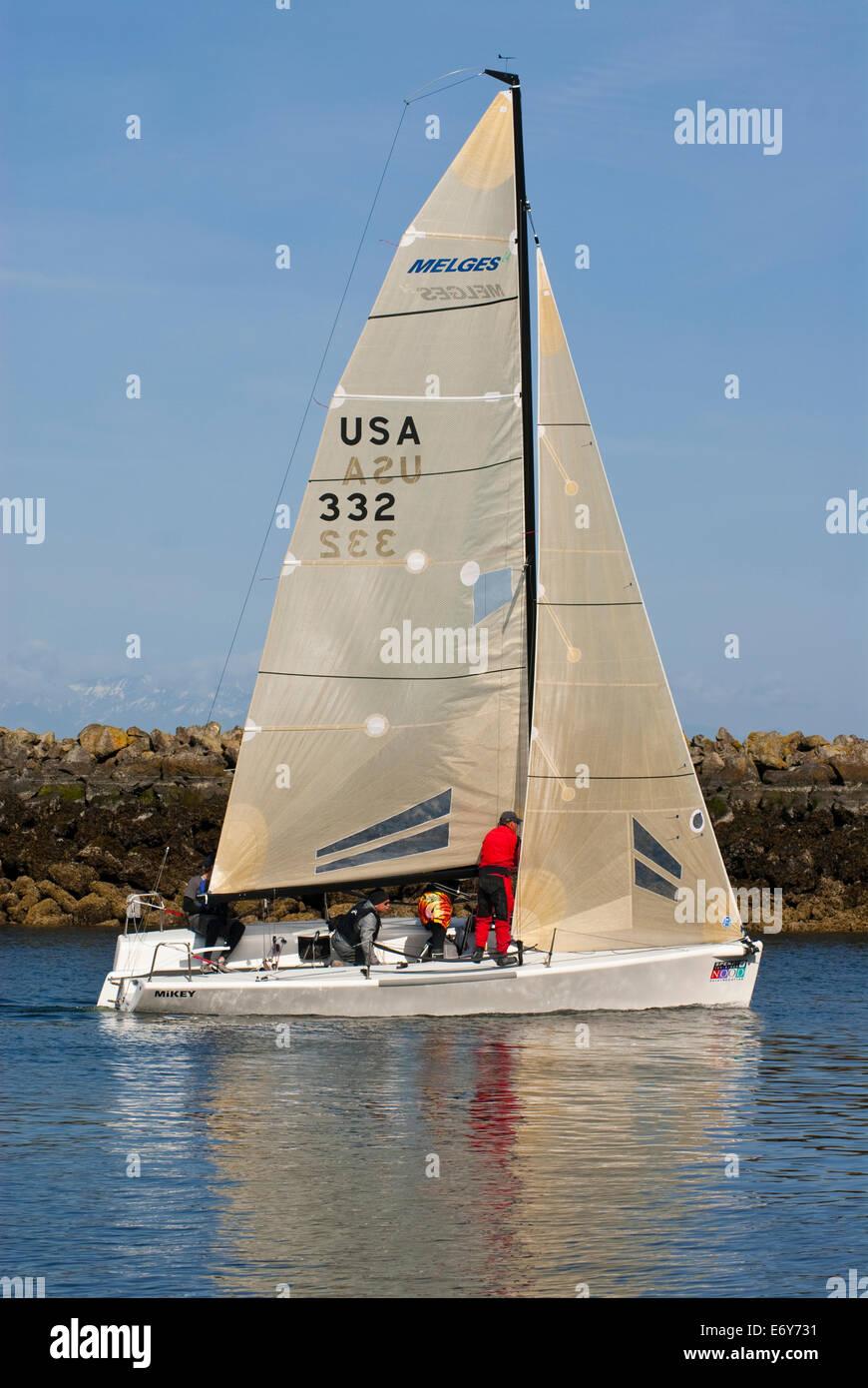 Sailboat Leaving Shilshole Bay Marina Seattle Washington State USA - Stock Image