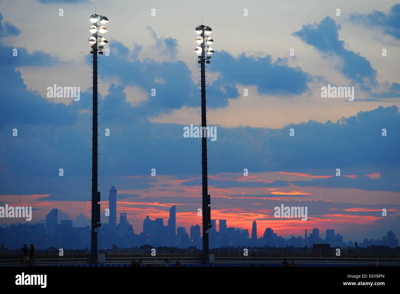 Flushing Meadows, New York, USA. 01st Sep, 2014. US Open tennis championships. The sun sets over Arthur Ashe stadium - Stock Image