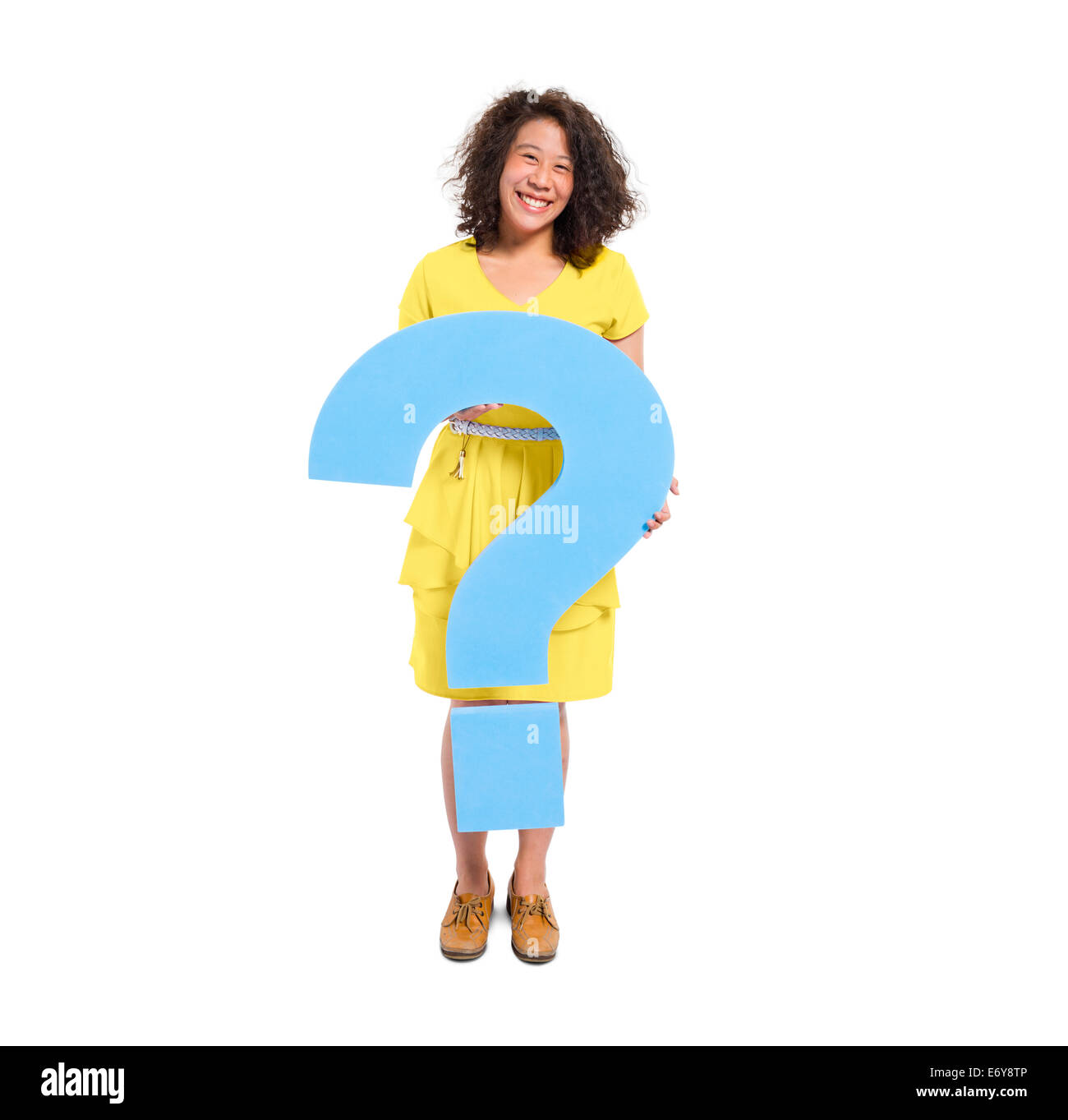 A Casual Woman Holding a Blue Question Mark - Stock Image