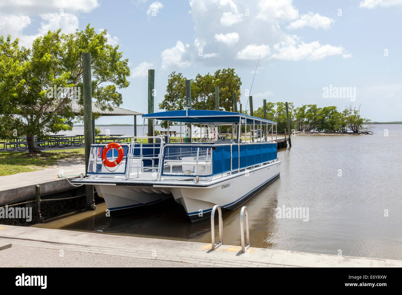 Stingray II, sightseeing pontoon boat docked in the Everglades City Marina, Florida, USA. - Stock Image