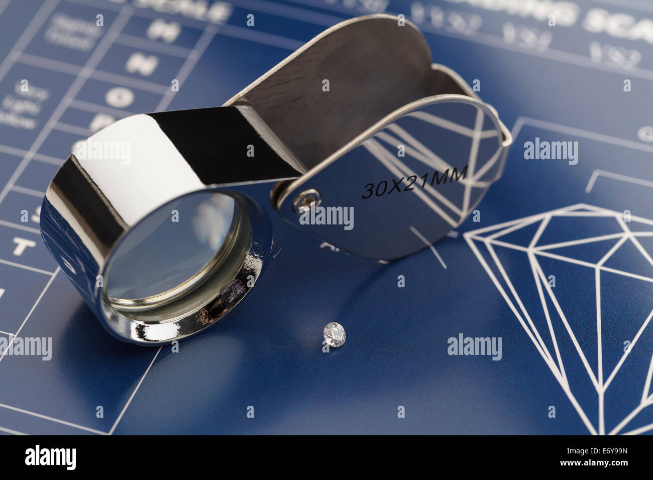 Blue Diamond Grading Chart with Diamonds and Loupe. - Stock Image