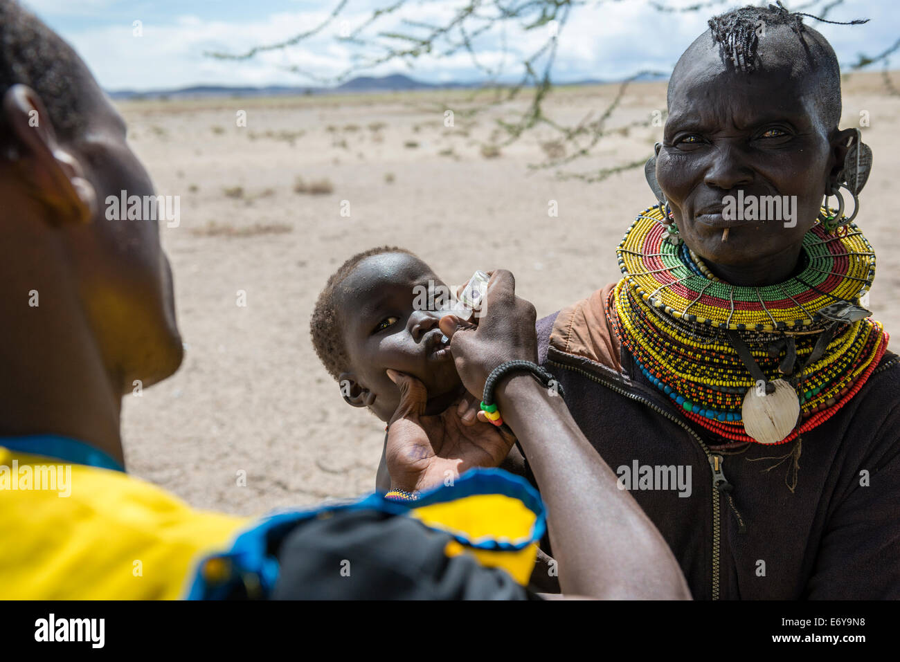 A mobile vaccination team visits a small Turkana village by the Turkana lake and vaccinates the infants and small - Stock Image