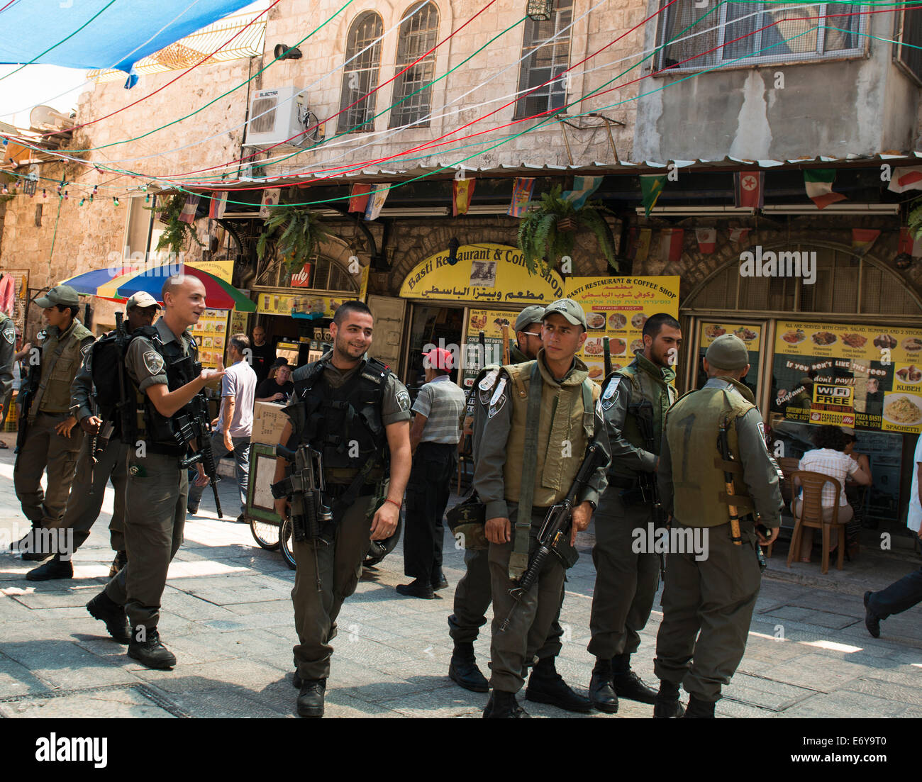 Israeli border policemen on duty in the Muslim quarter in the old city of Jerusalem. - Stock Image