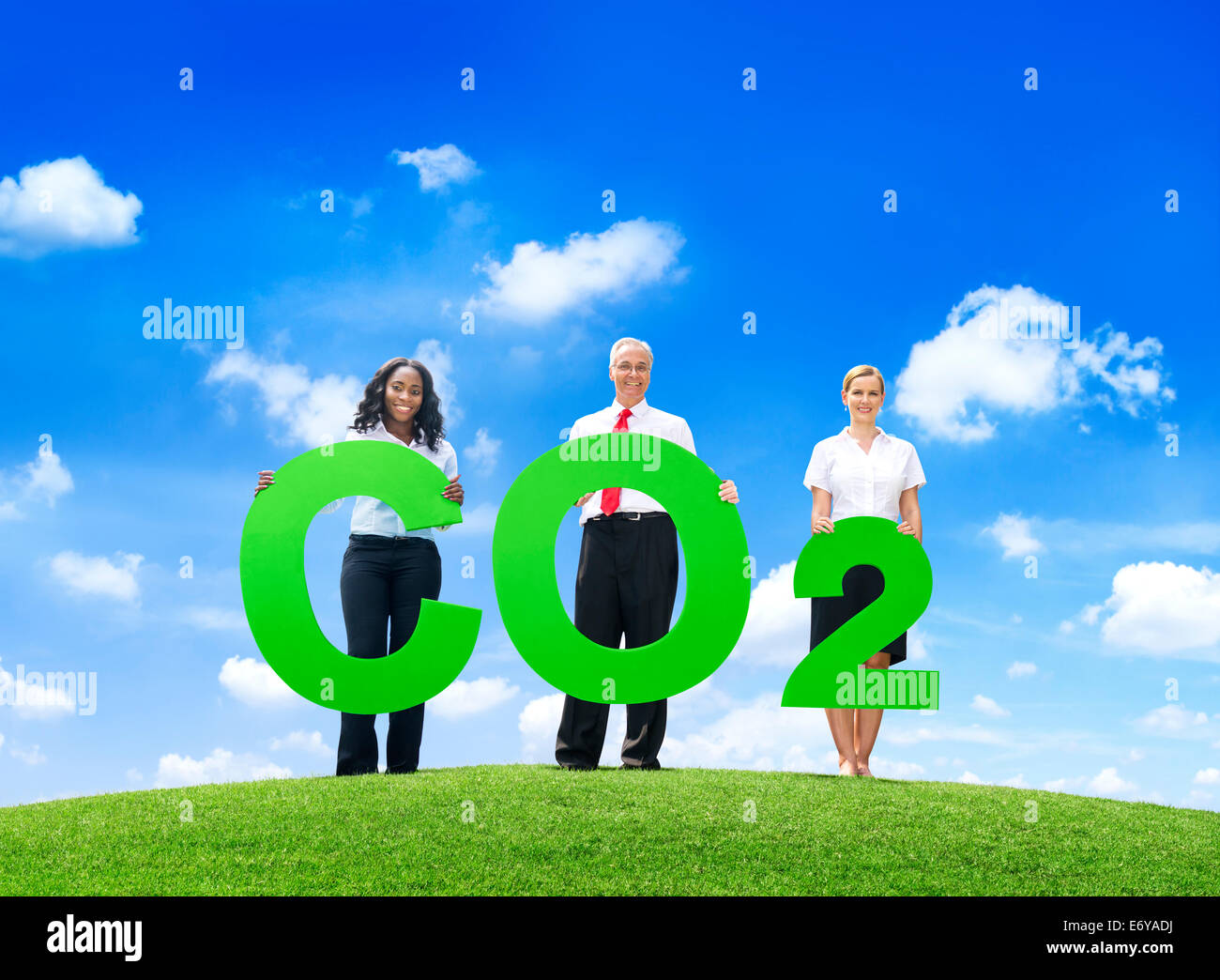 Business People Holding Carbon Dioxide Outdoors - Stock Image