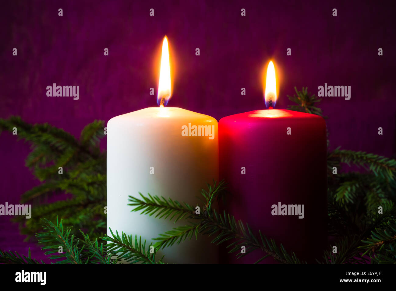 Christmas ornaments. Lighted candles and spruce twigs Stock Photo ...