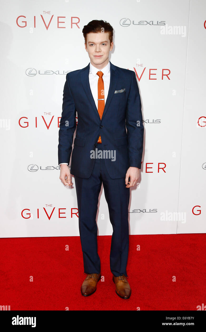 Actor Cameron Monaghan attends the premiere of 'The Giver' at the Ziegfeld Theatre on August 11, 2014 in - Stock Image