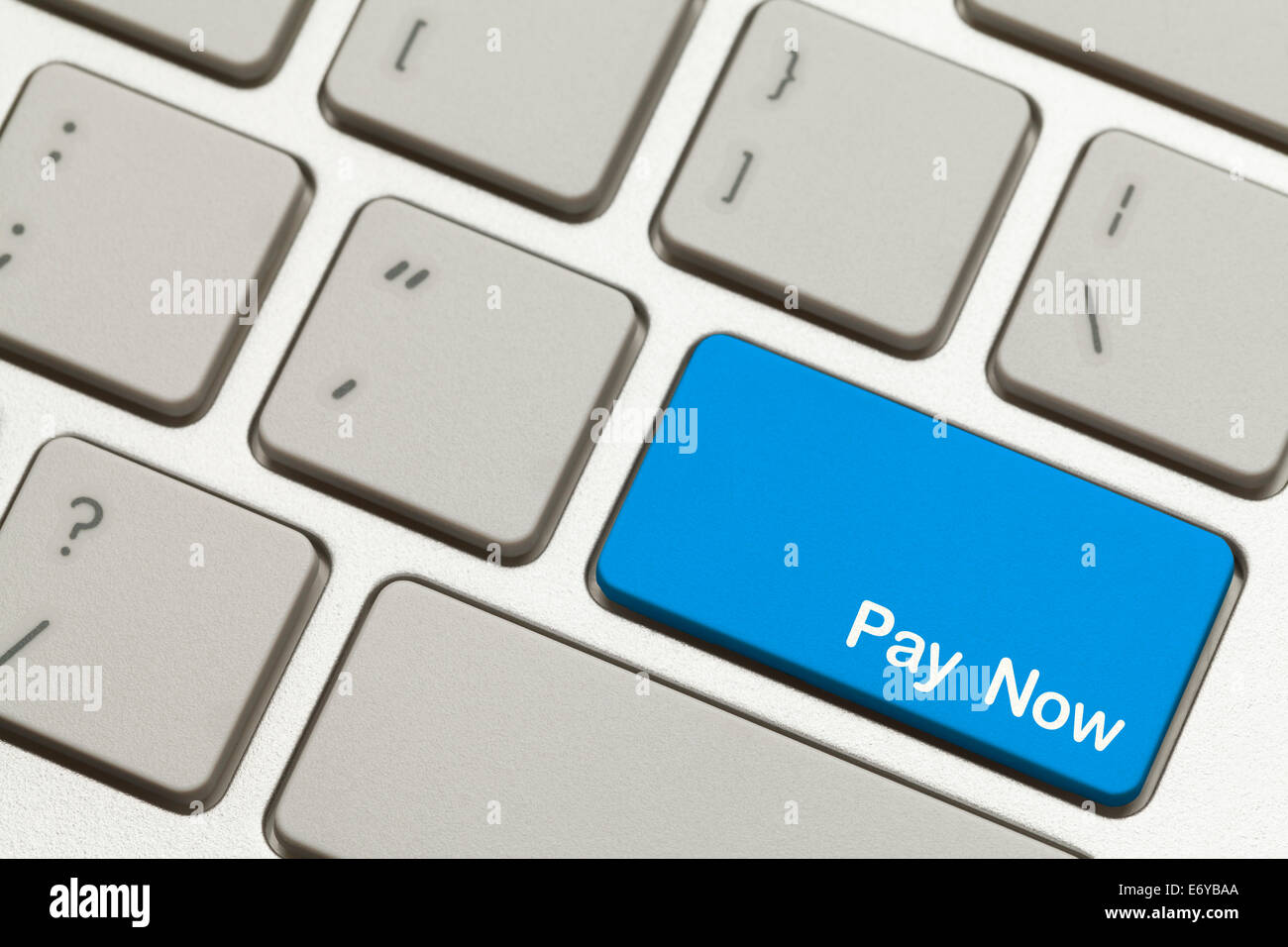 Close Up of Blue Pay Now Key Button on Keyboard. - Stock Image