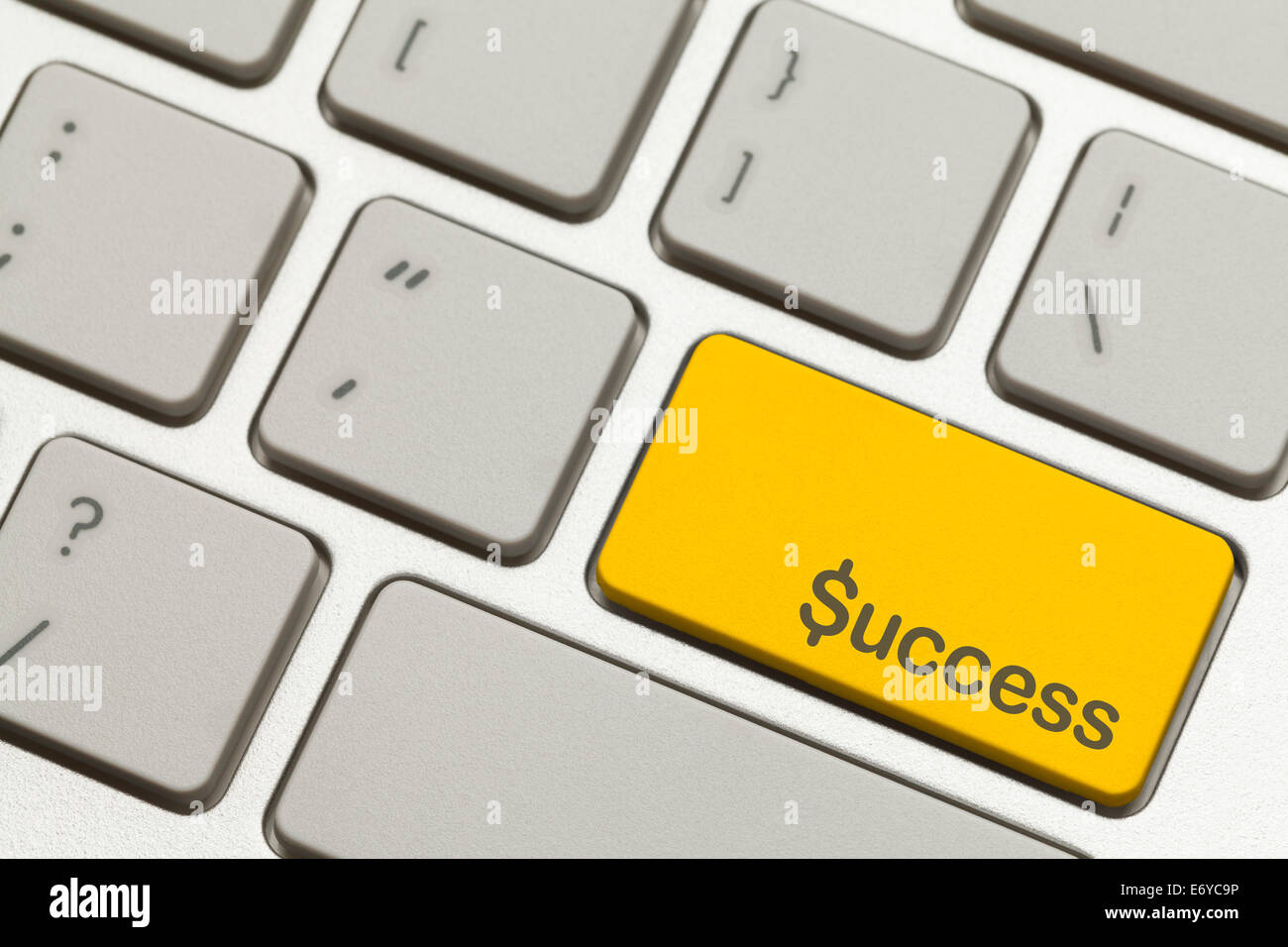 Close Up of Gold Success Key Button on a Keyboard. - Stock Image