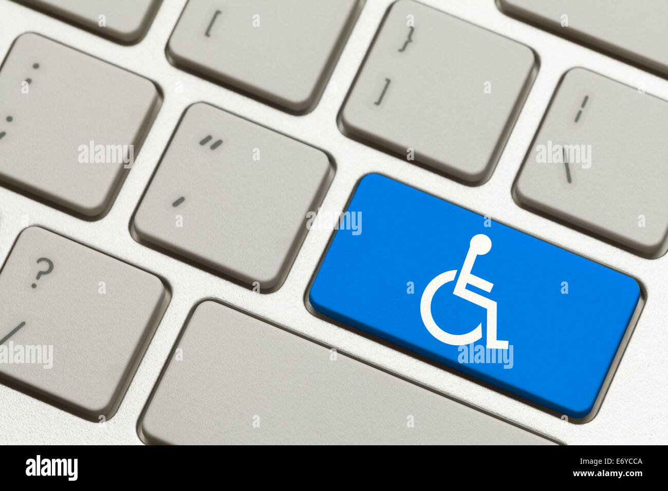 Close Up of Blue Handicap Key Button on a Keyboard. - Stock Image