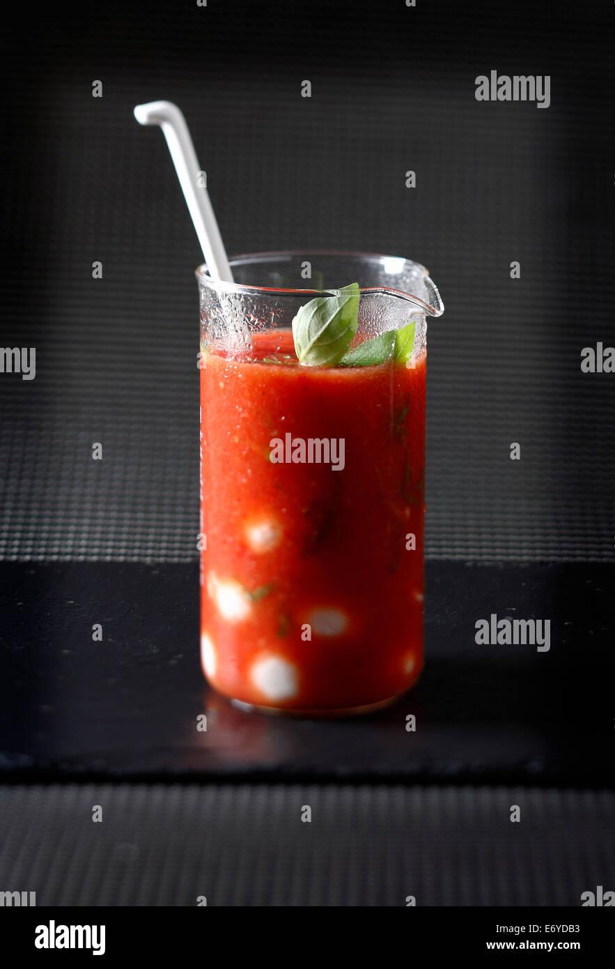 Tomato juice with basil - Stock Image