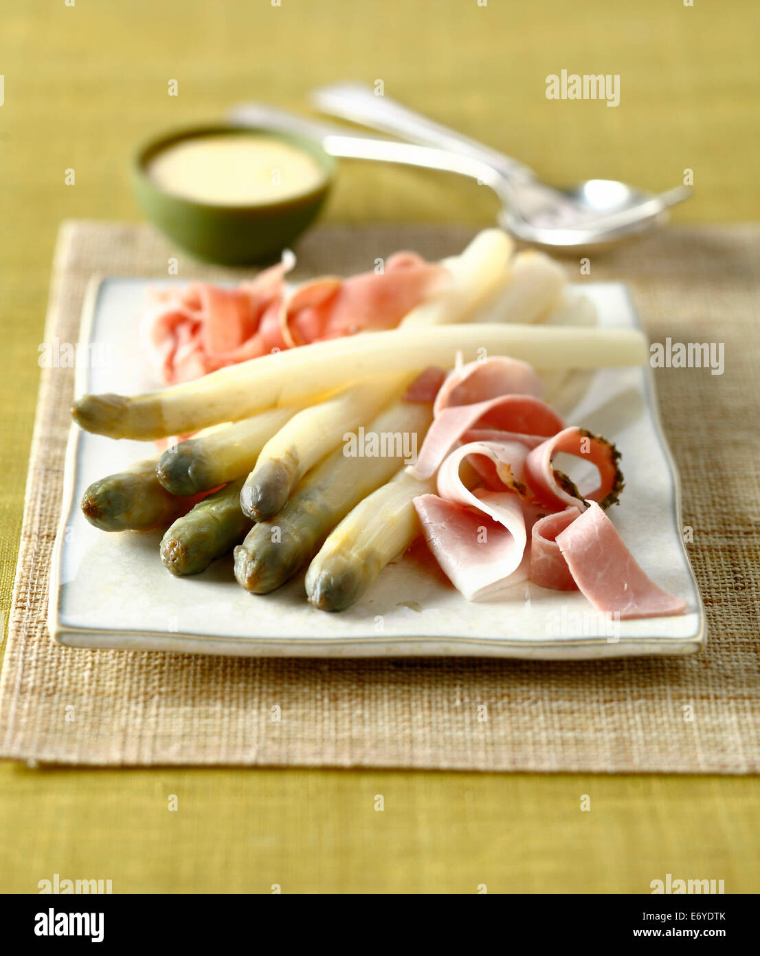 Asparagus with raw and boiled ham,mousseline sauce - Stock Image