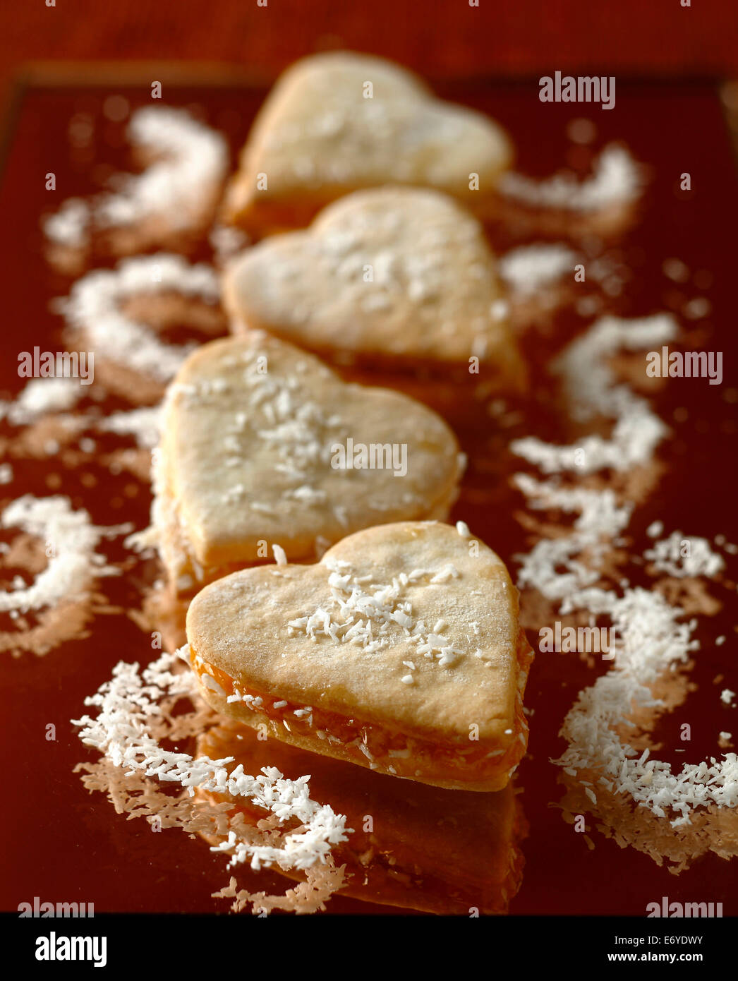 Heart-shaped coconut Oriental pastries - Stock Image