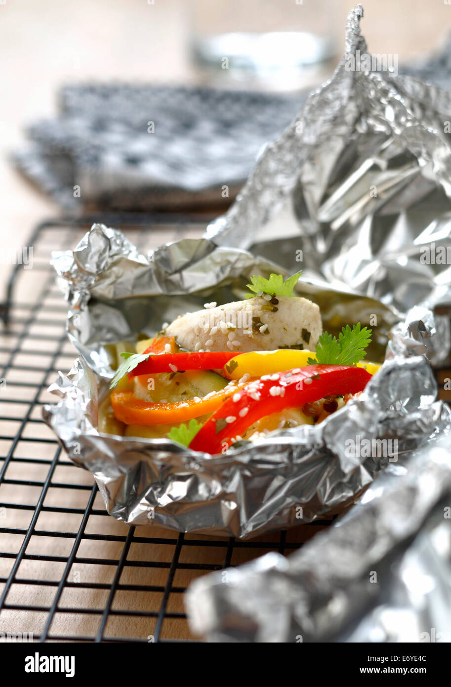 Oriental-style steamed rabbit cooked in aluminium foil - Stock Image