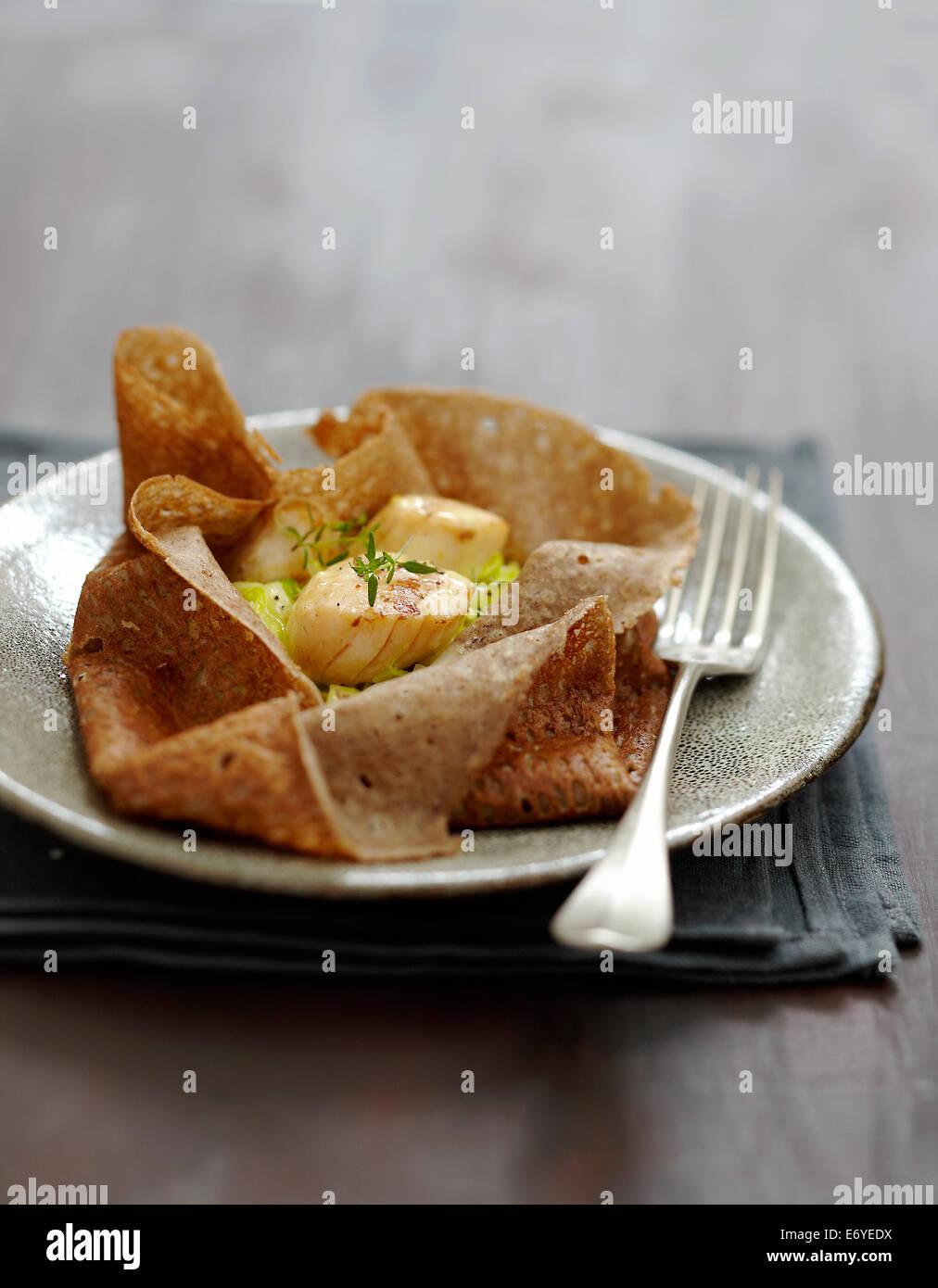 Scallop and leek pancake purse - Stock Image
