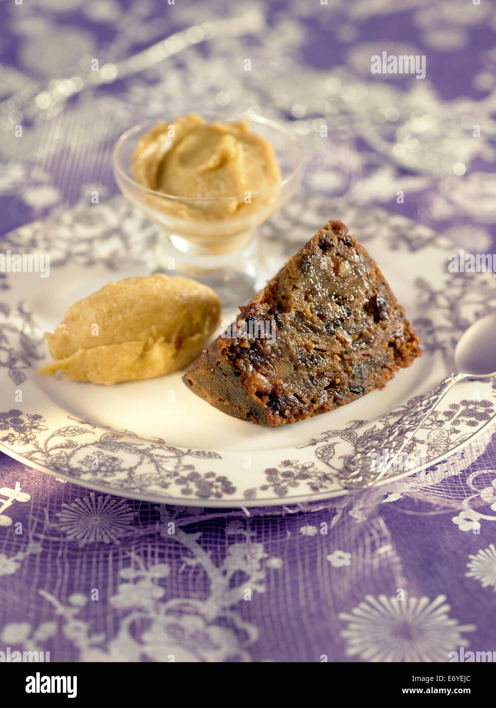 Christmas pudding with brandy butter Stock Photo