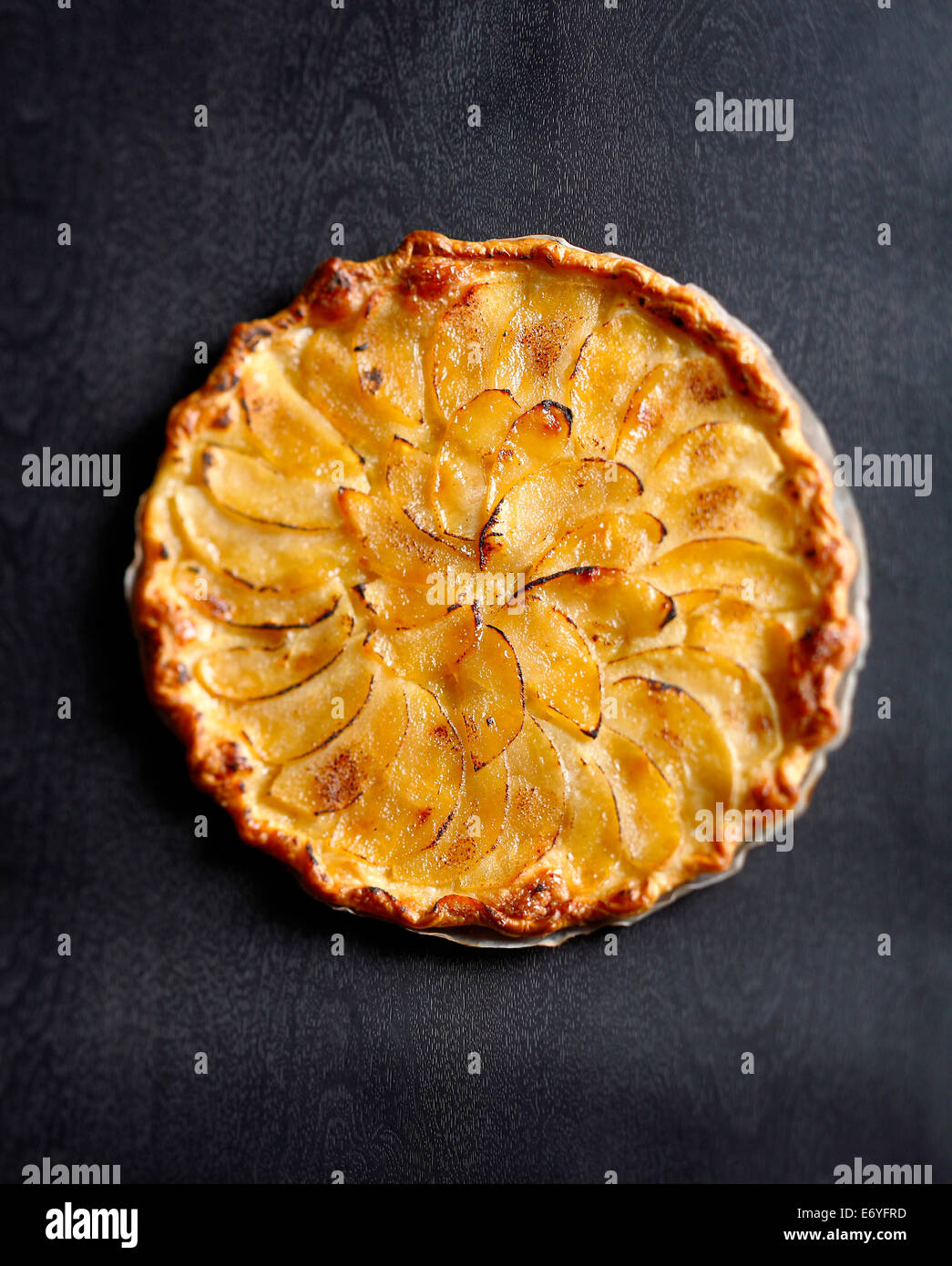 Thin apple and salted butter tart - Stock Image
