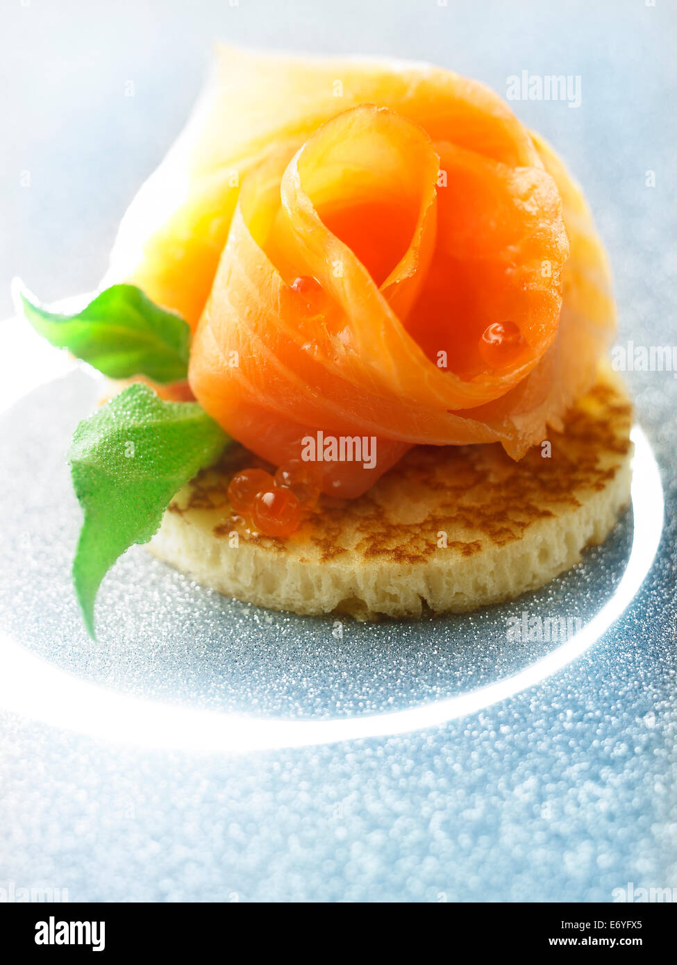 Organic smoked salmon on toast - Stock Image