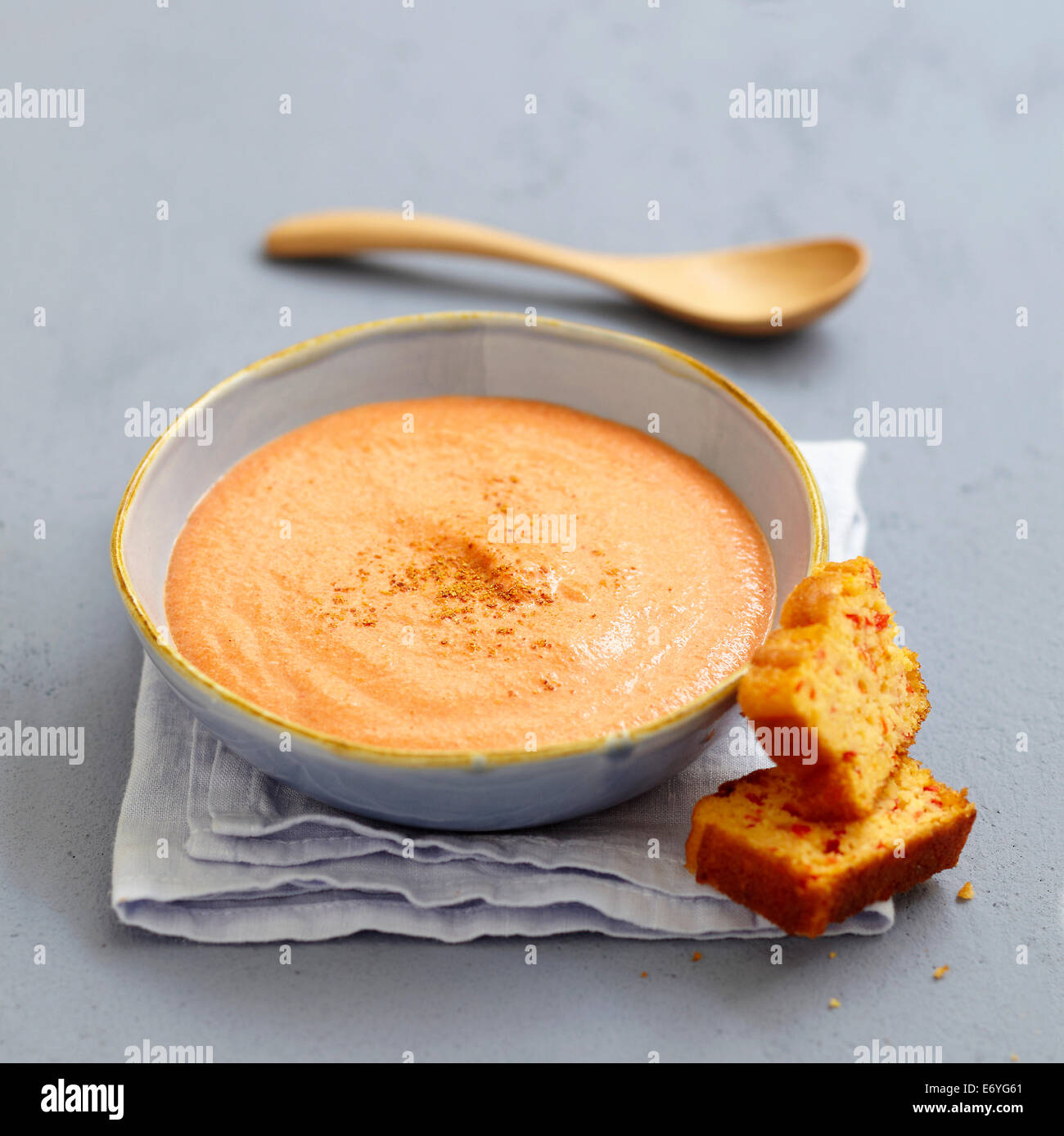 Cream of red pepper soup with sweet corn bread Stock Photo