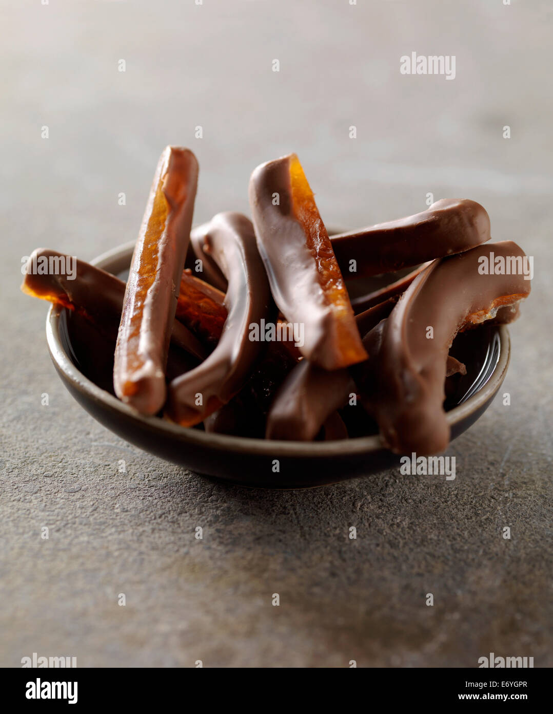 Grapefruit rinds coated in milk chocolate - Stock Image