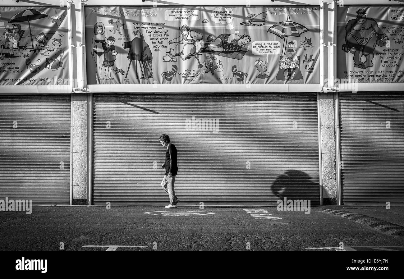 Woman Walking Along Skegness Promenade . - Stock Image
