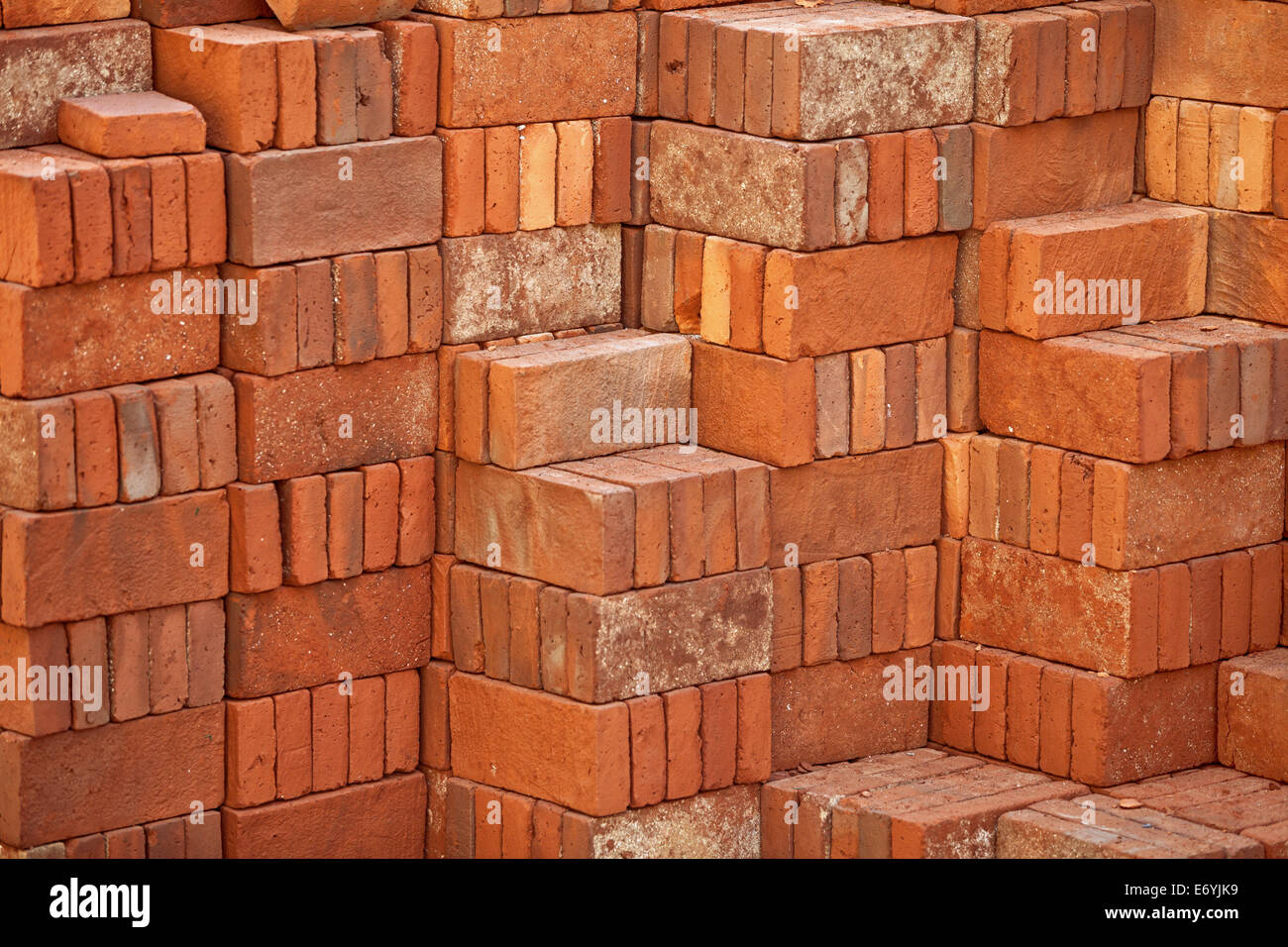 Pile of clay red bricks prepared forbuilding - Stock Image