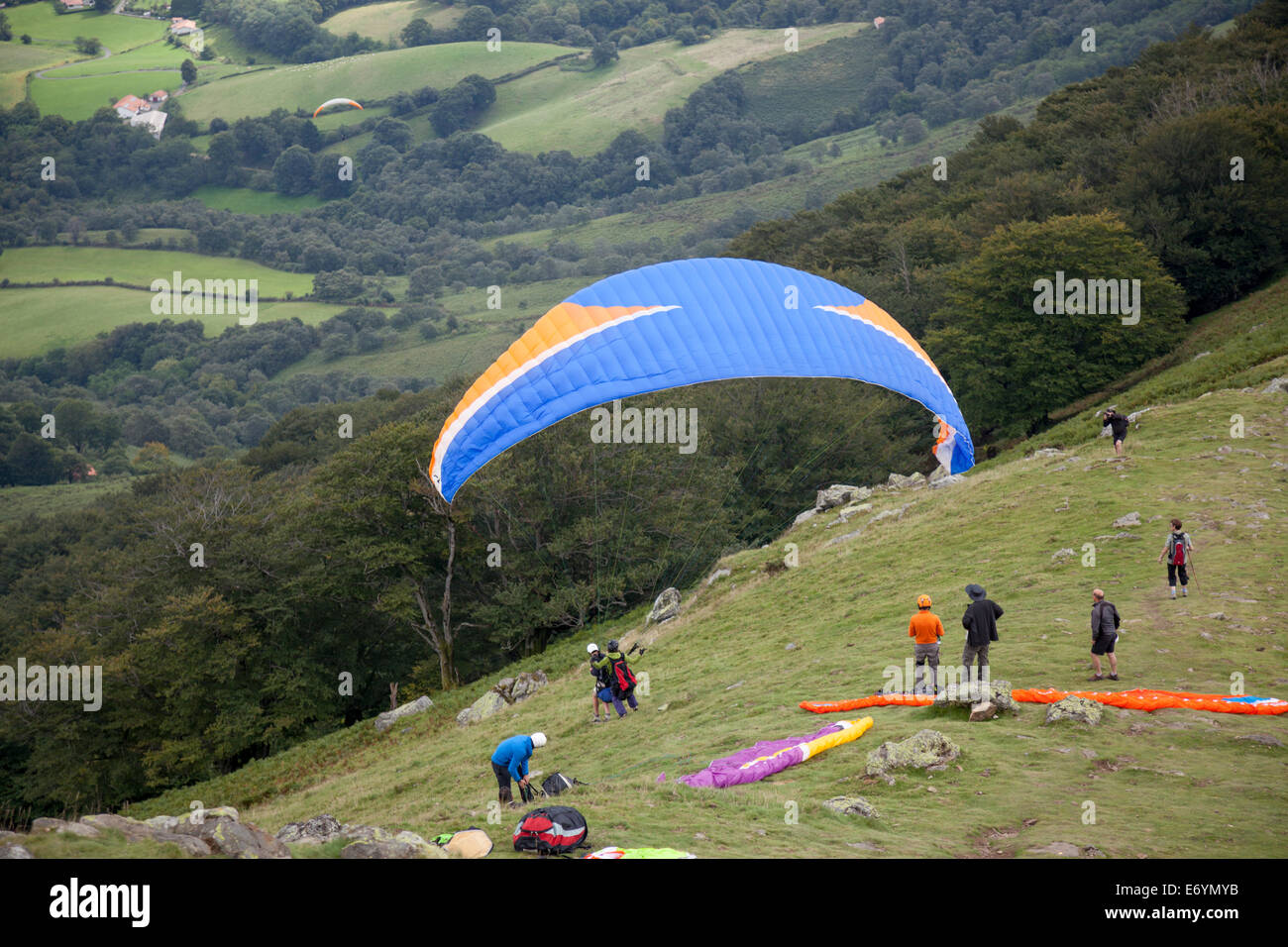 At the Baïgoura summit (2,942 feet), paragliders ready for their takeoff (French Basque country - Aquitaine - France). Stock Photo
