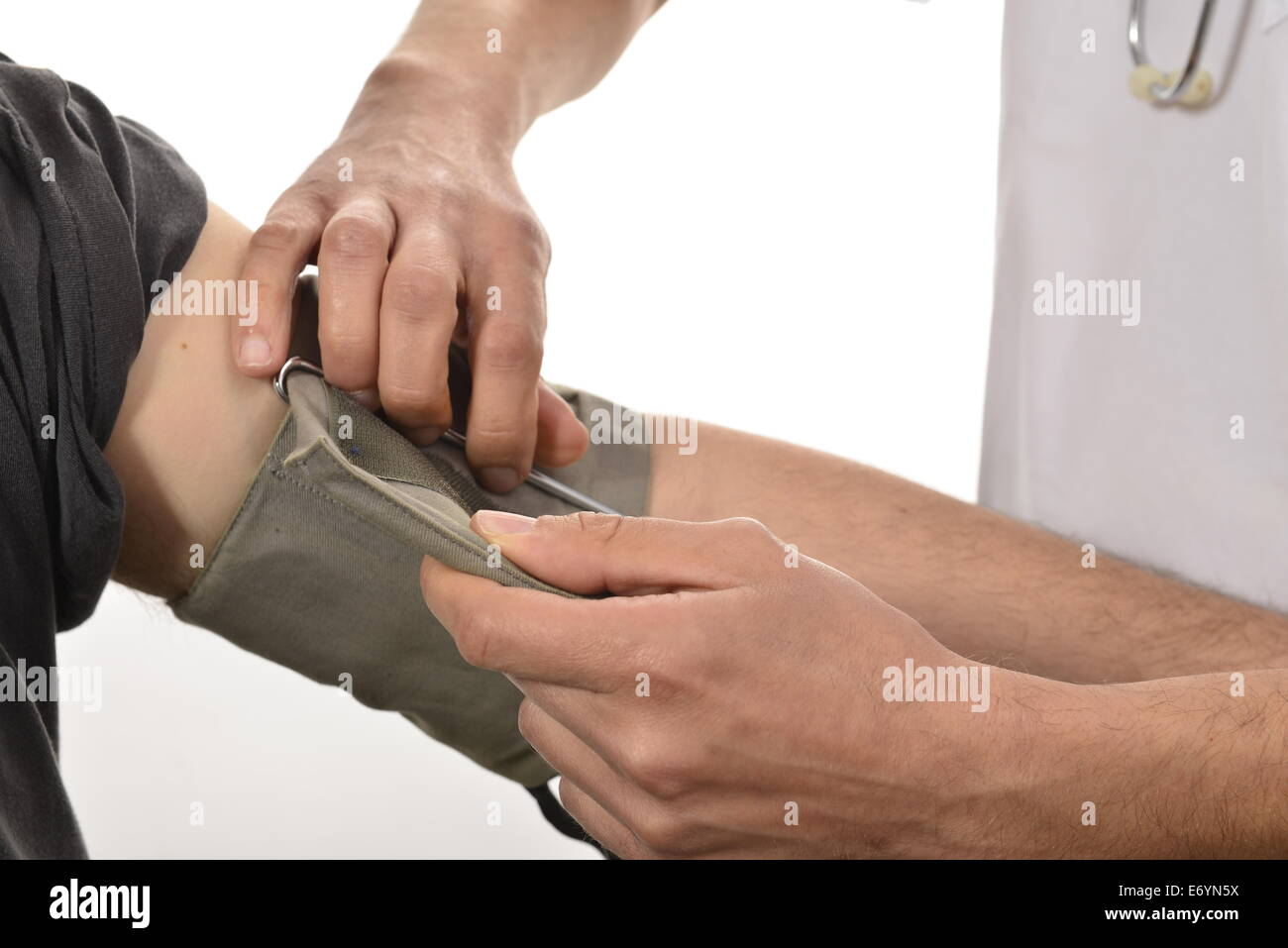 Nurse preparing blood pressure check - Stock Image
