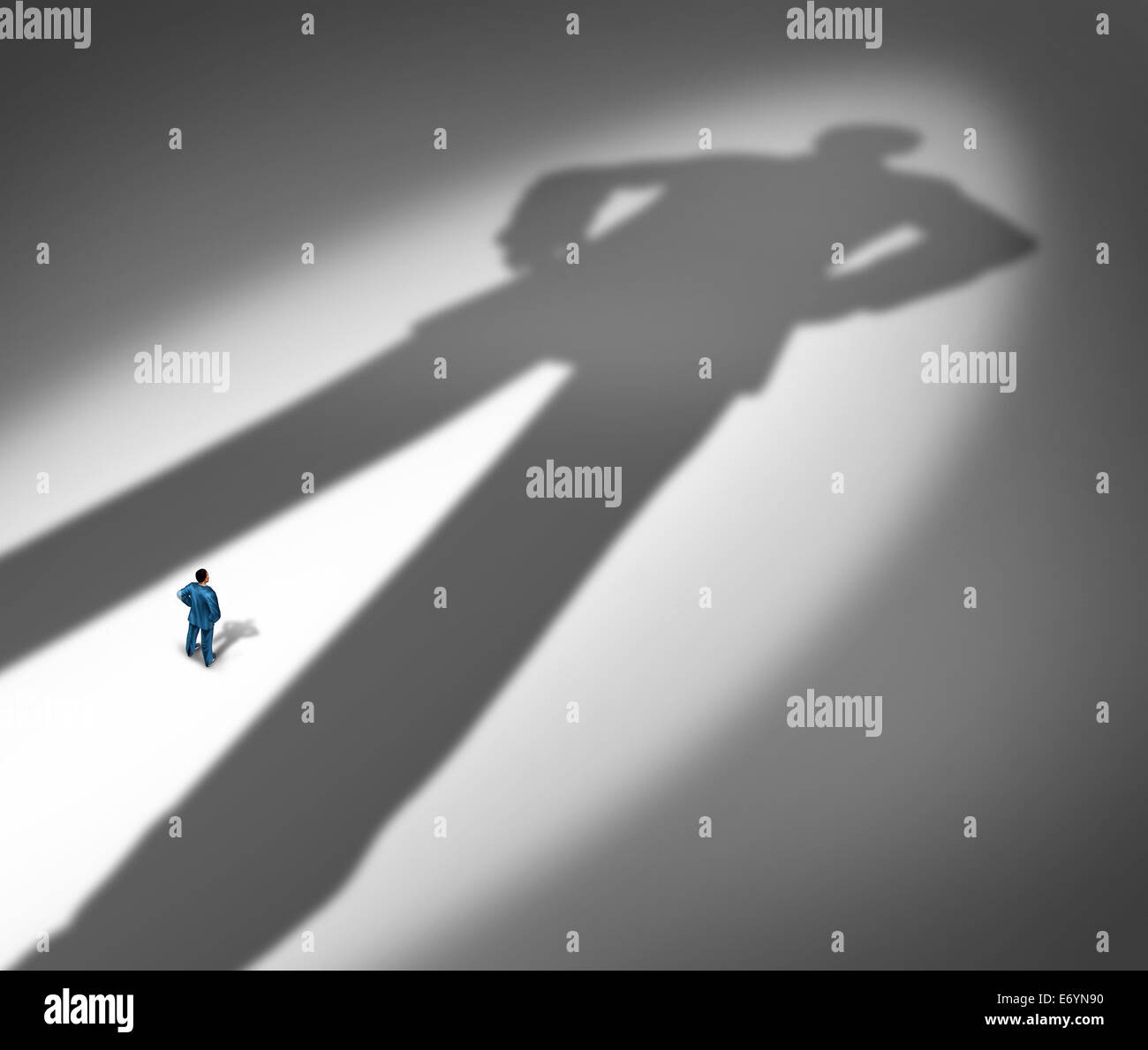 Under a shadow business metaphor for living under a powerful leader or the little guy or small business competing - Stock Image