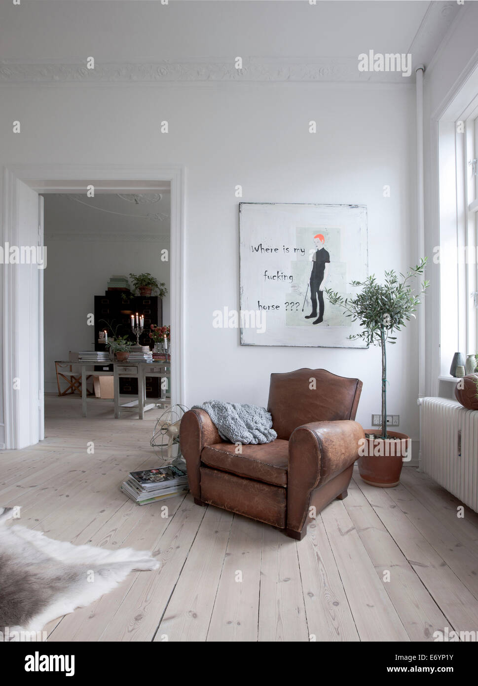 Bohemian living room, with vintage recliner in leather Stock Photo ...